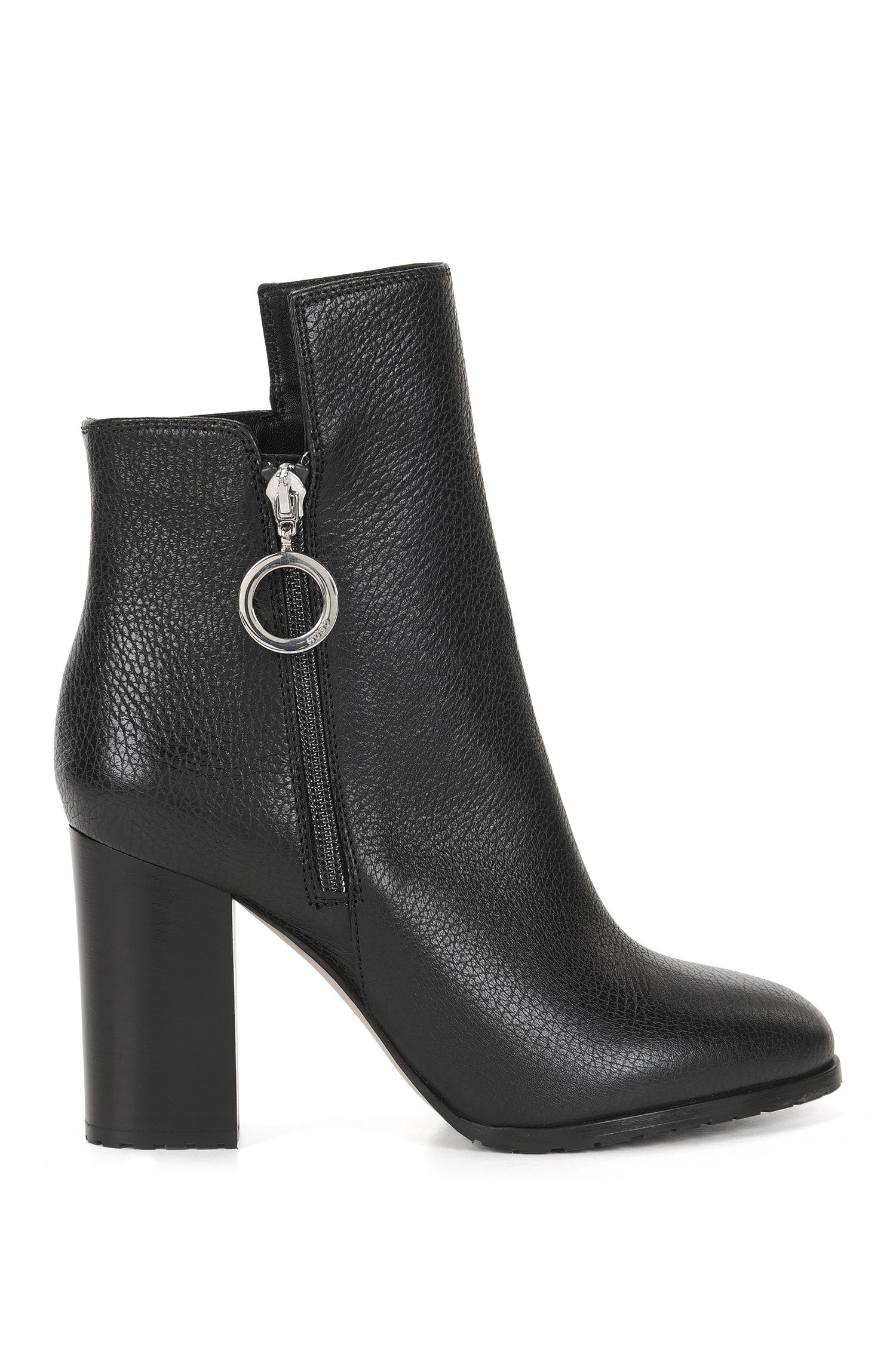 Ring-detailed ankle boots in Italian leather