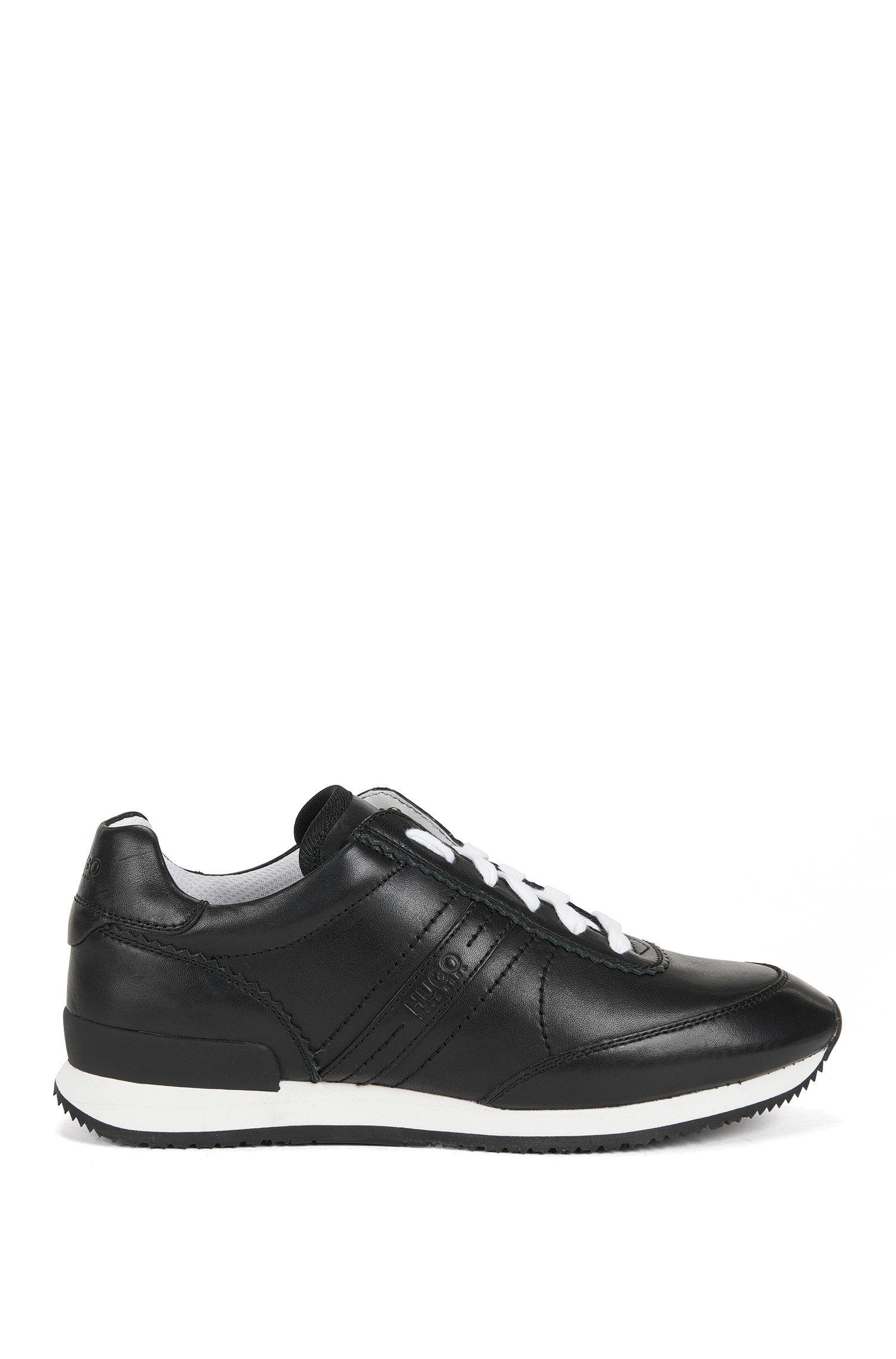 Sneakers interamente in pelle con suola in gomma