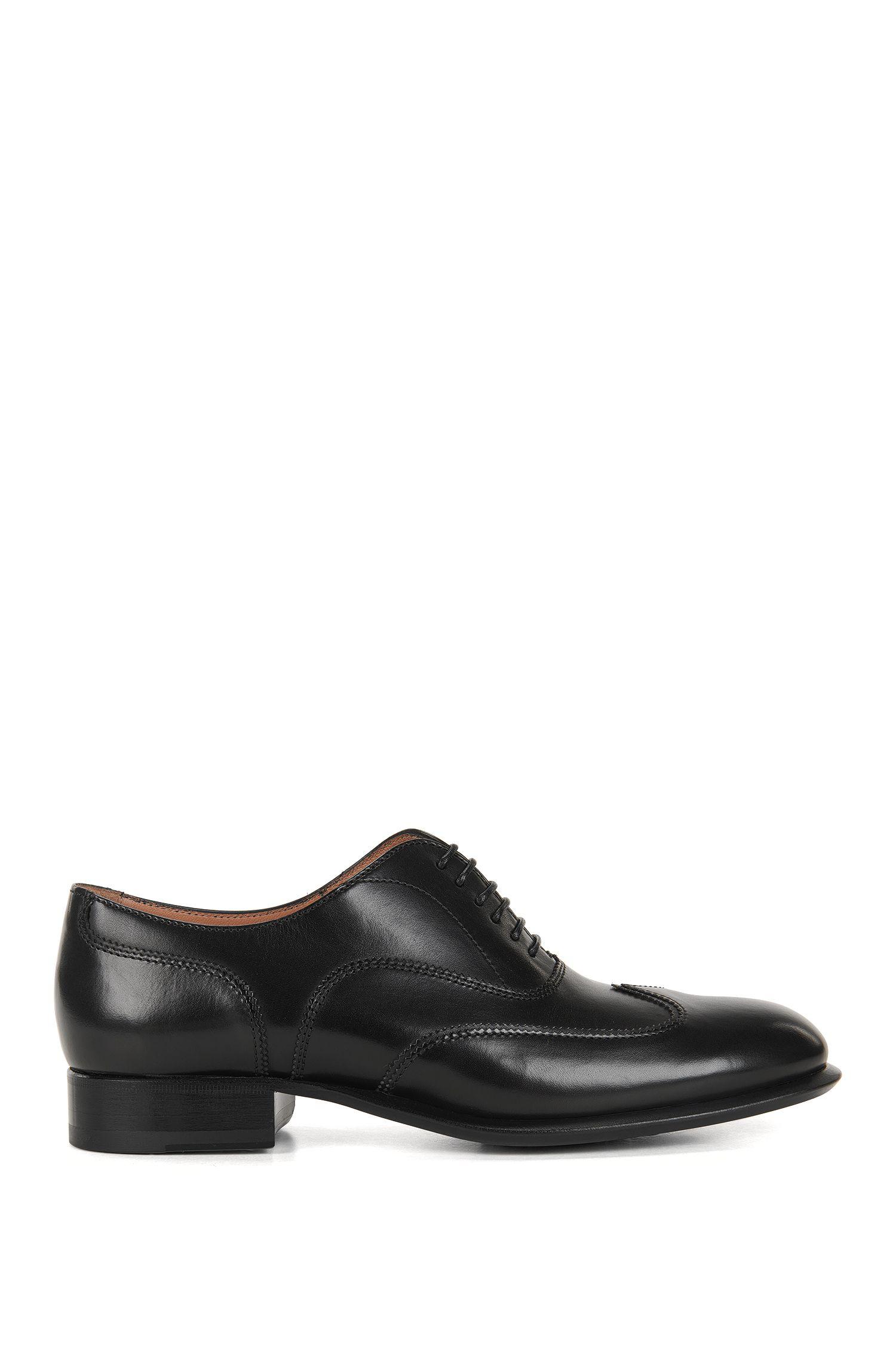 Zapatos formales con cordones de piel