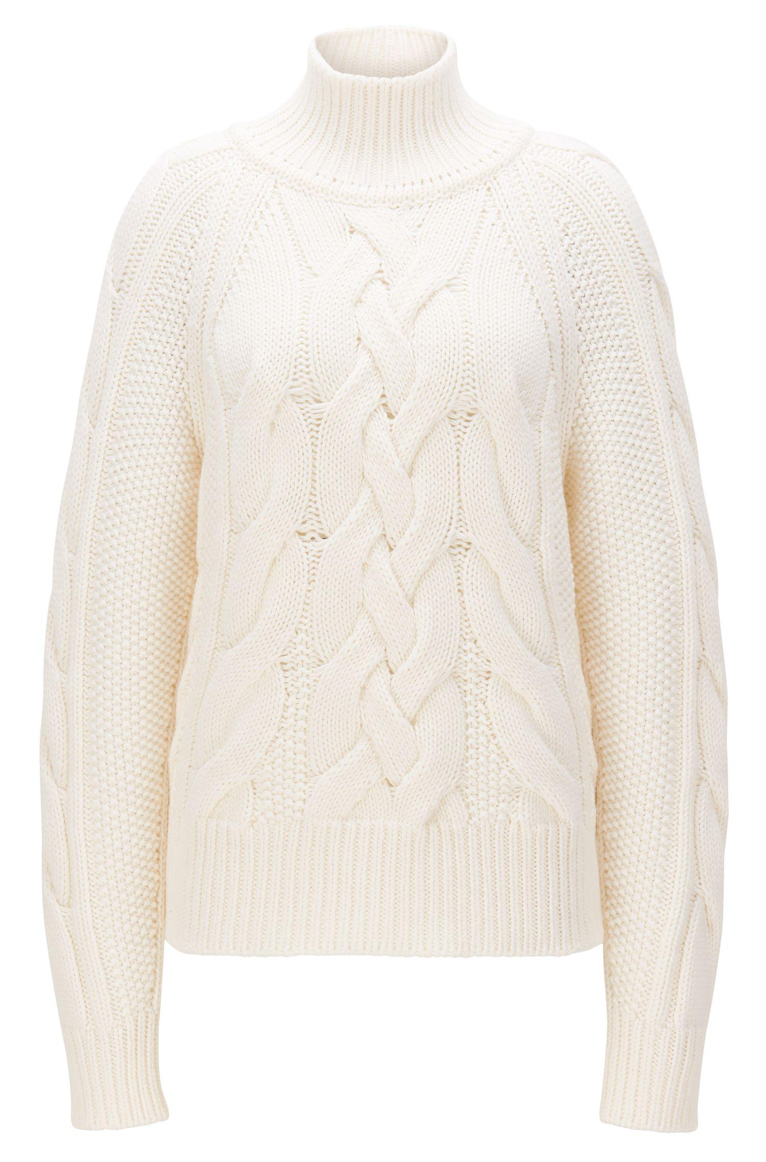 Gebreide trui van scheerwol met kabelpatroon
