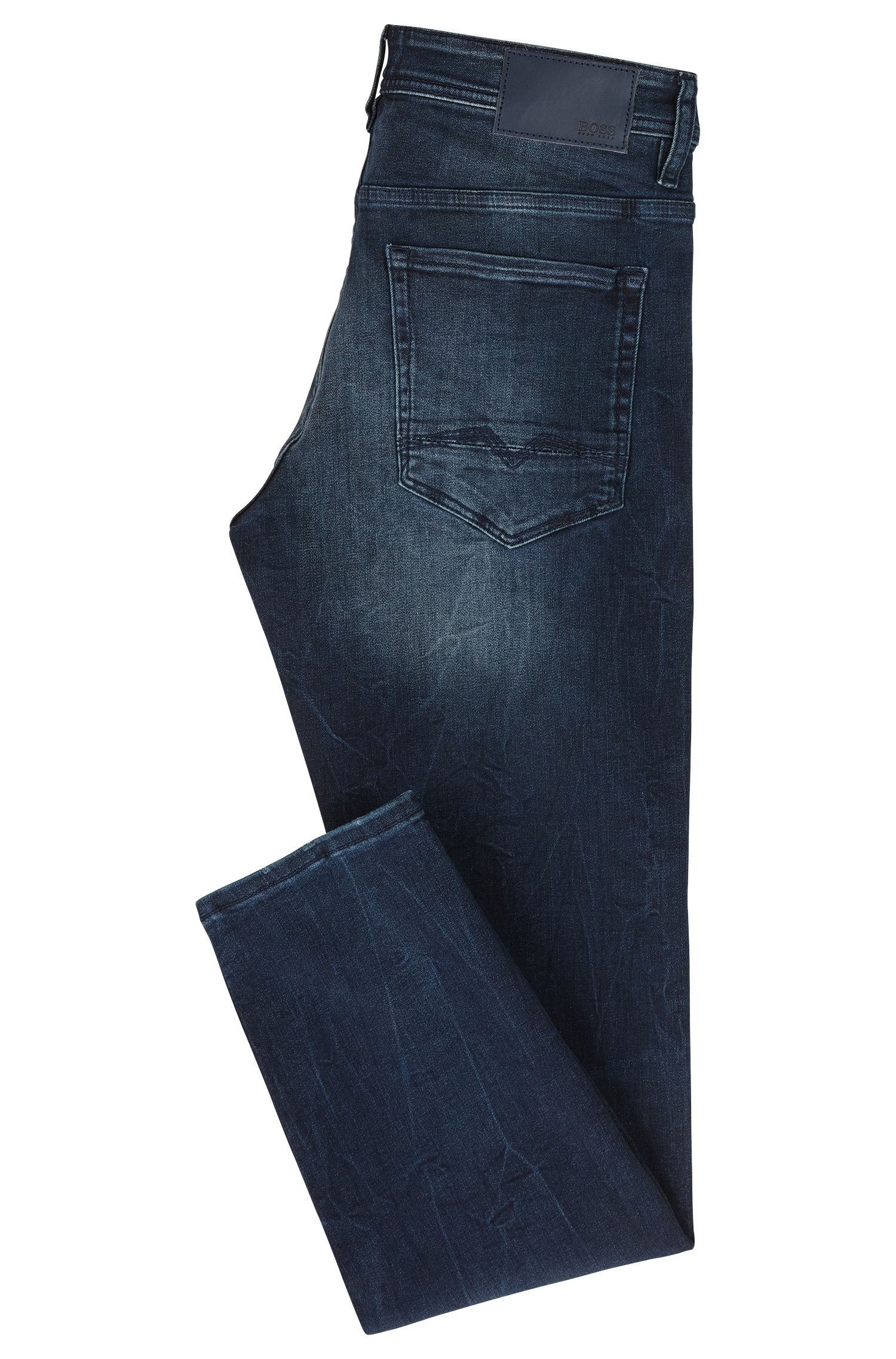 Jean fuselé Tapered Fit en denim super stretch indigo profond, à la finition usée