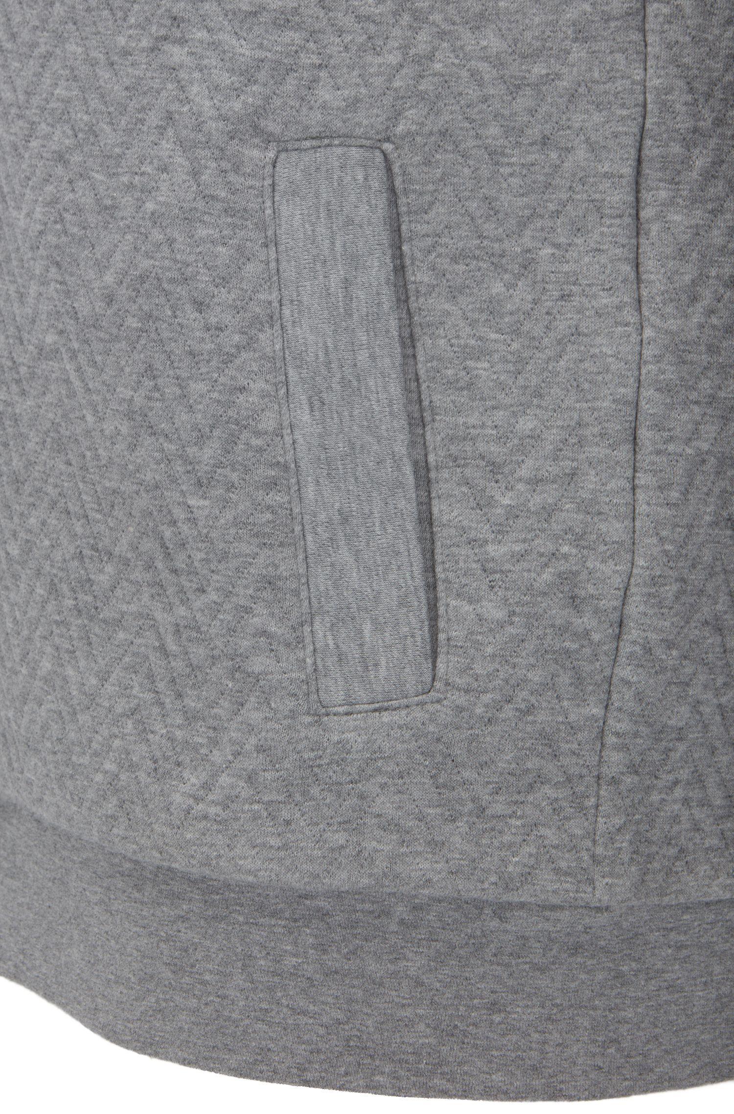 Veste matelassée à capuche Regular Fit en coton, à motif chevrons