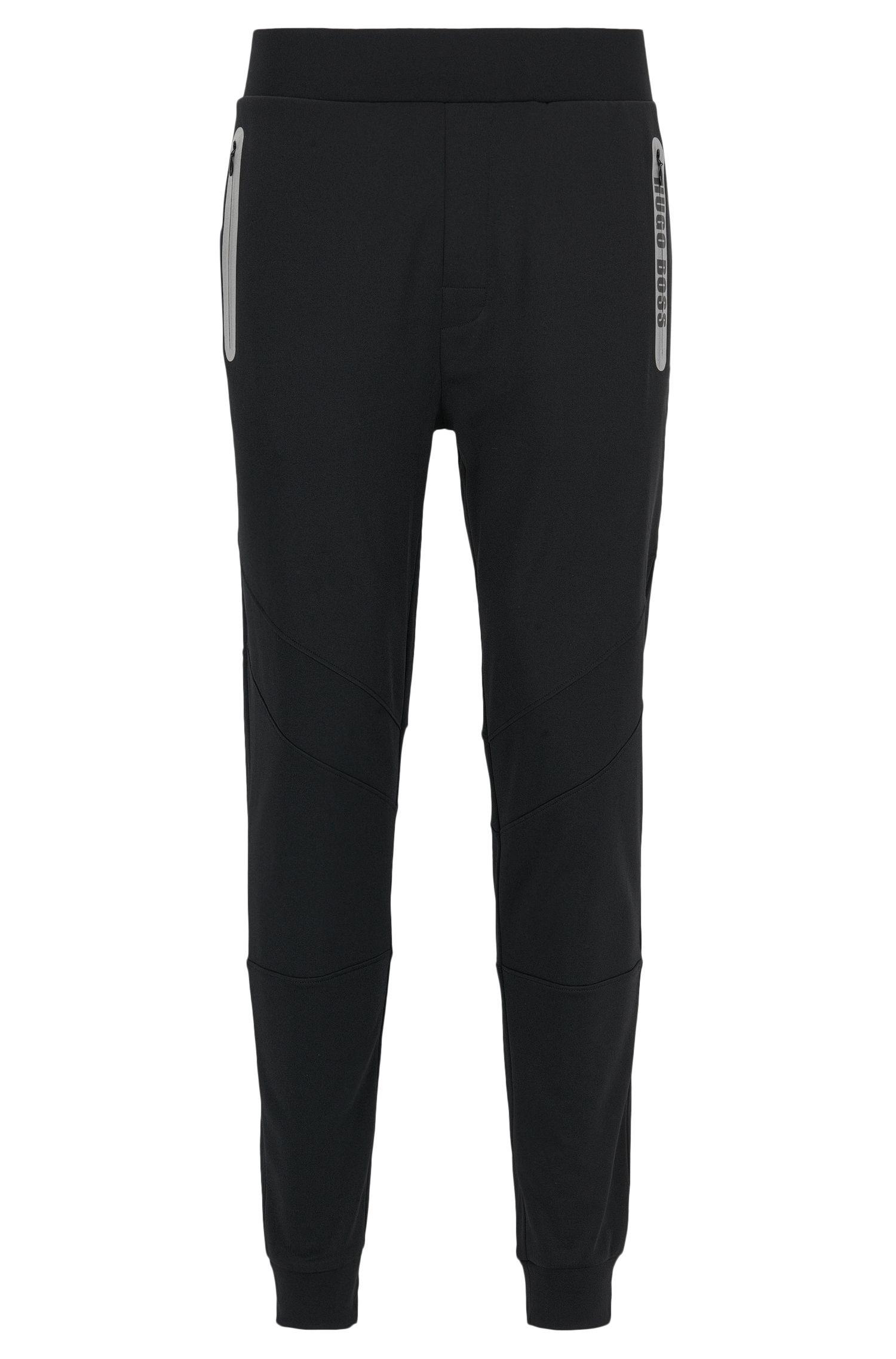 Pantaloni per il tempo libero in misto cotone elasticizzato con bordo sul fondo gamba e dettagli sportivi