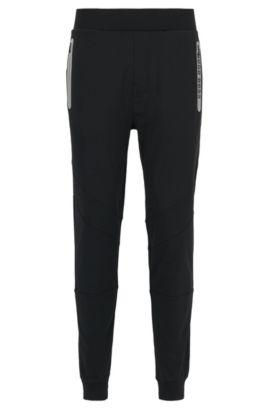 Pantaloni per il tempo libero in misto cotone elasticizzato con bordo sul fondo gamba e dettagli sportivi, Nero