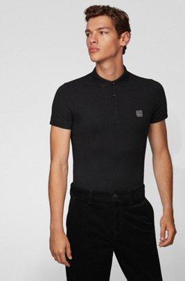 Poloshirt aus gewaschenem Piqué mit Logo-Aufnäher, Schwarz