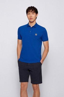 Poloshirt aus gewaschenem Piqué mit Logo-Aufnäher, Blau