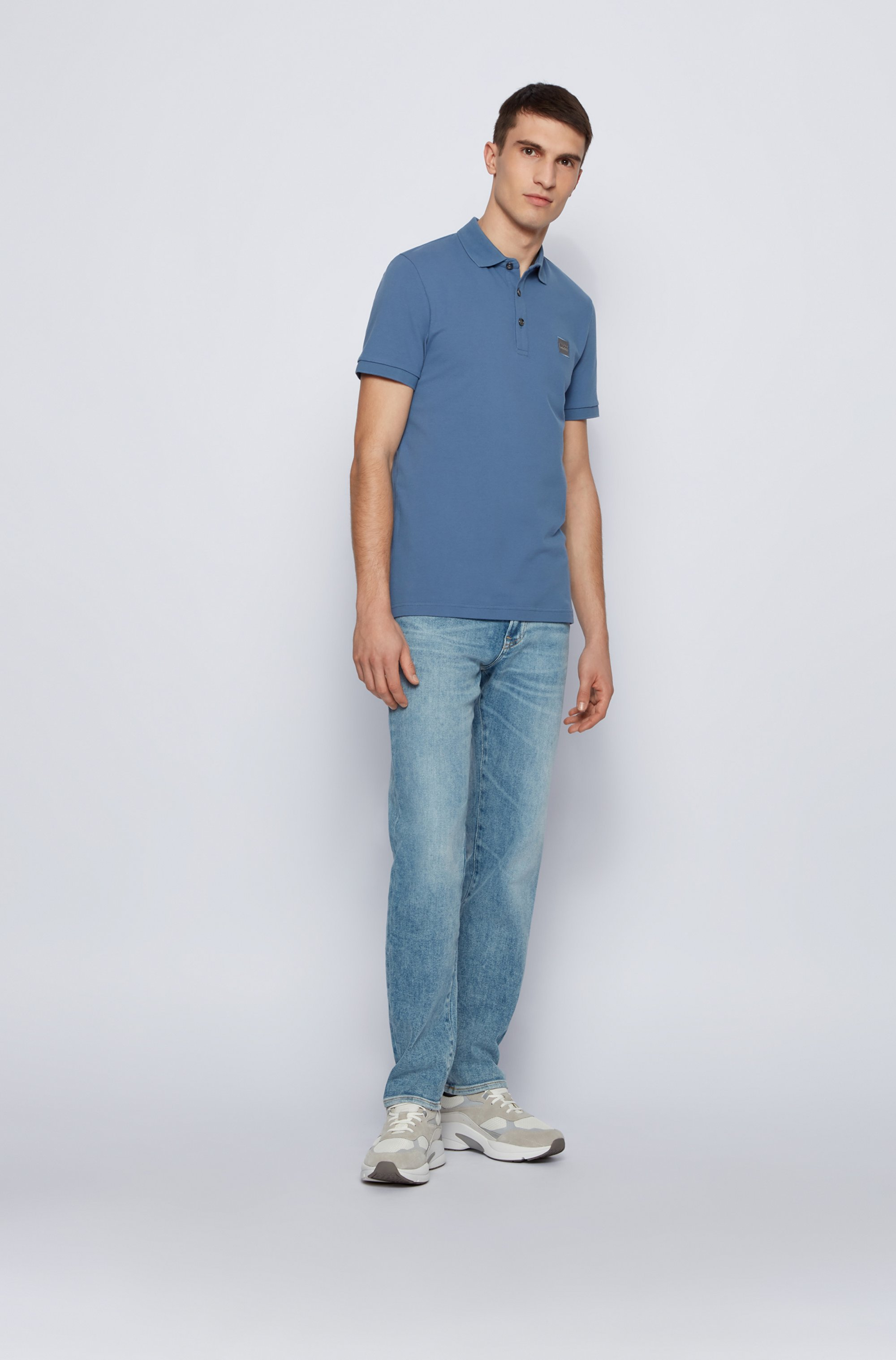 Slim-fit polo shirt in washed piqué with logo patch