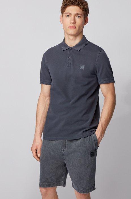Slim-Fit Poloshirt aus gewaschenem Baumwoll-Piqué, Dunkelblau