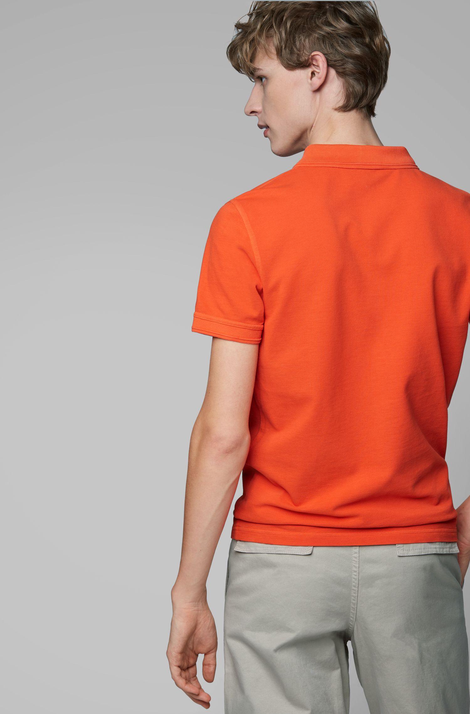 Slim-Fit Poloshirt aus gewaschenem Baumwoll-Piqué, Orange