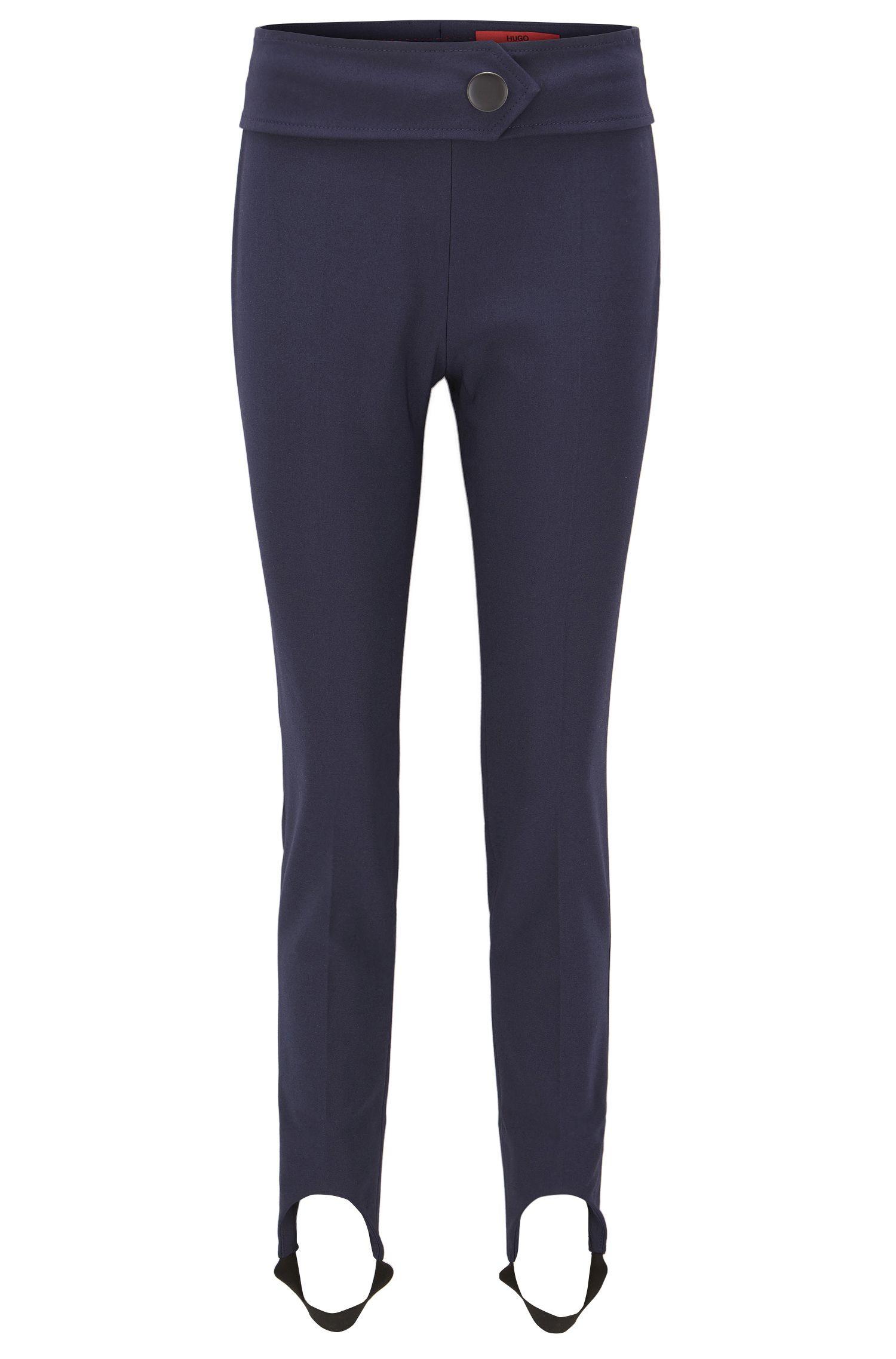 Skinny-fit broek met voetbandjes, van een katoenmix met stretch