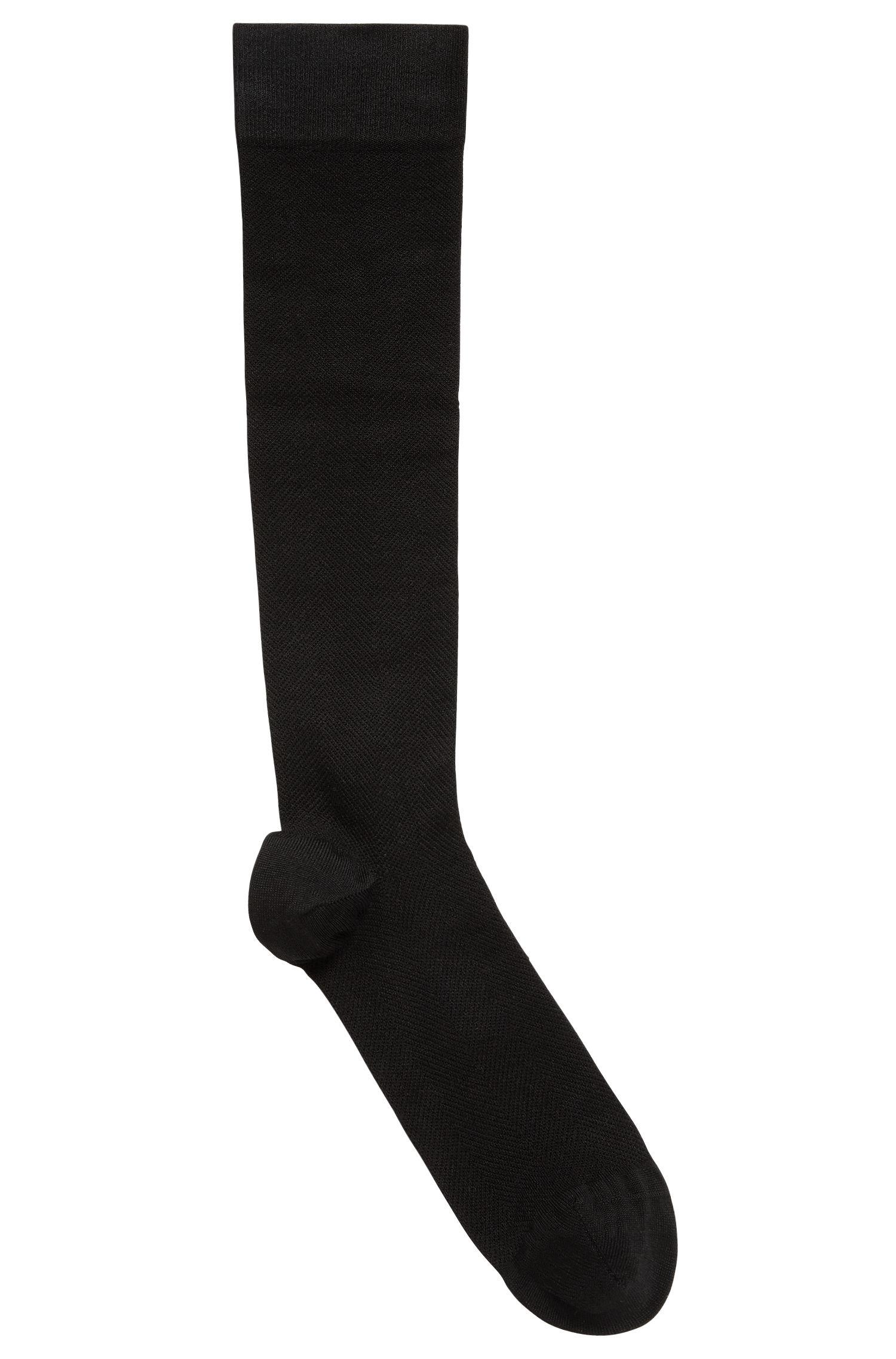 Chaussettes hautes de compression en matière technique