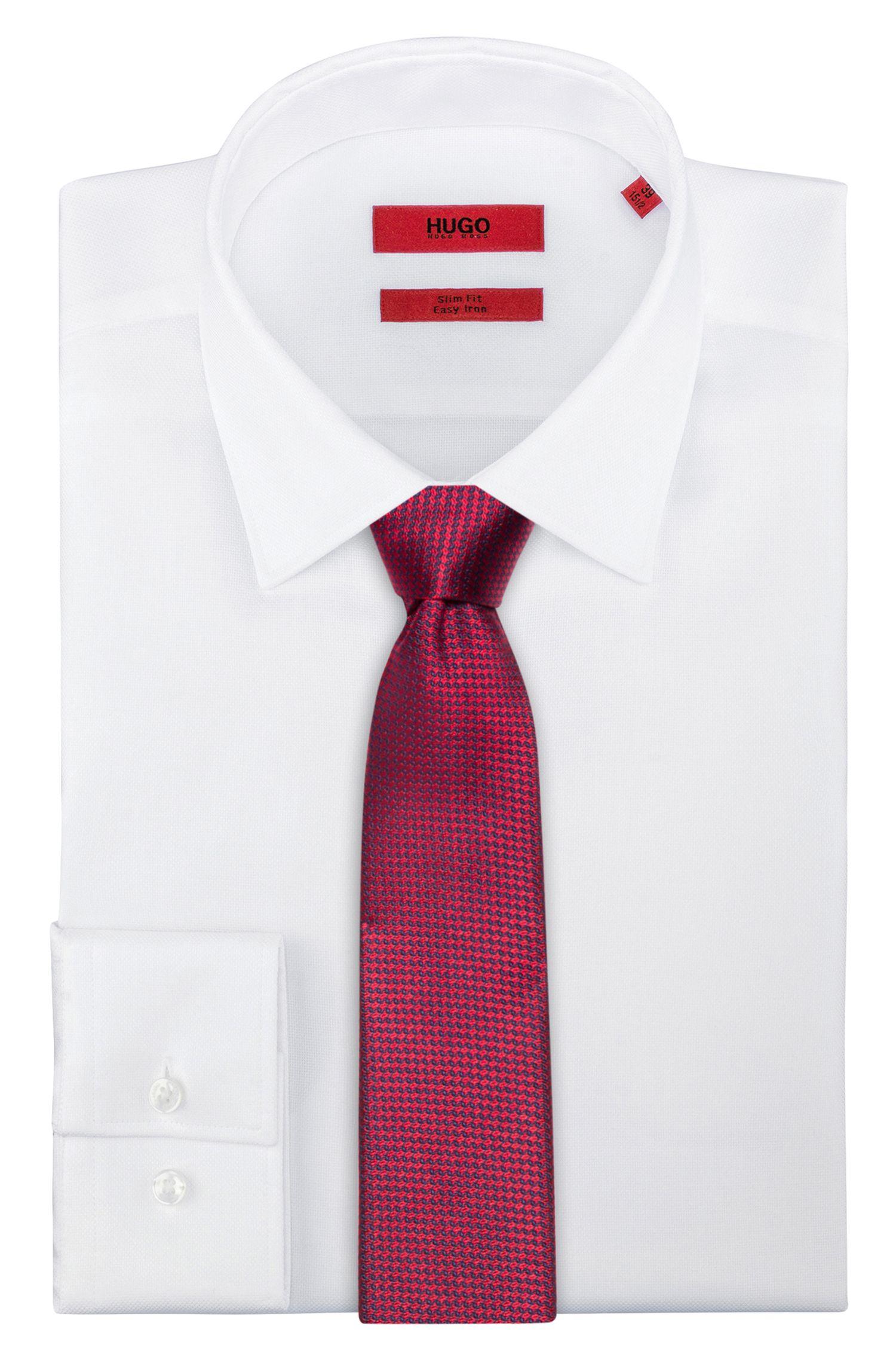 Cravate en jacquard de soie à motif