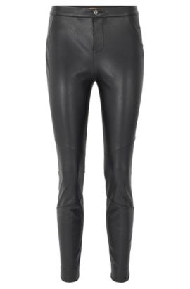 Slim-fit trousers in faux leather, Black