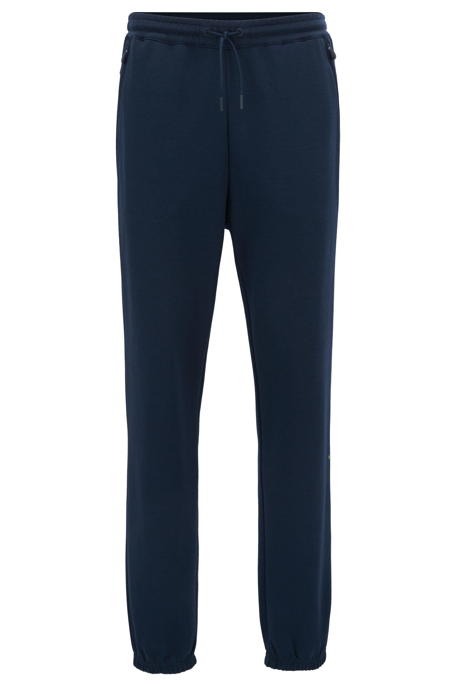 Pantalones slim fit en mezcla de algodón repelente al agua