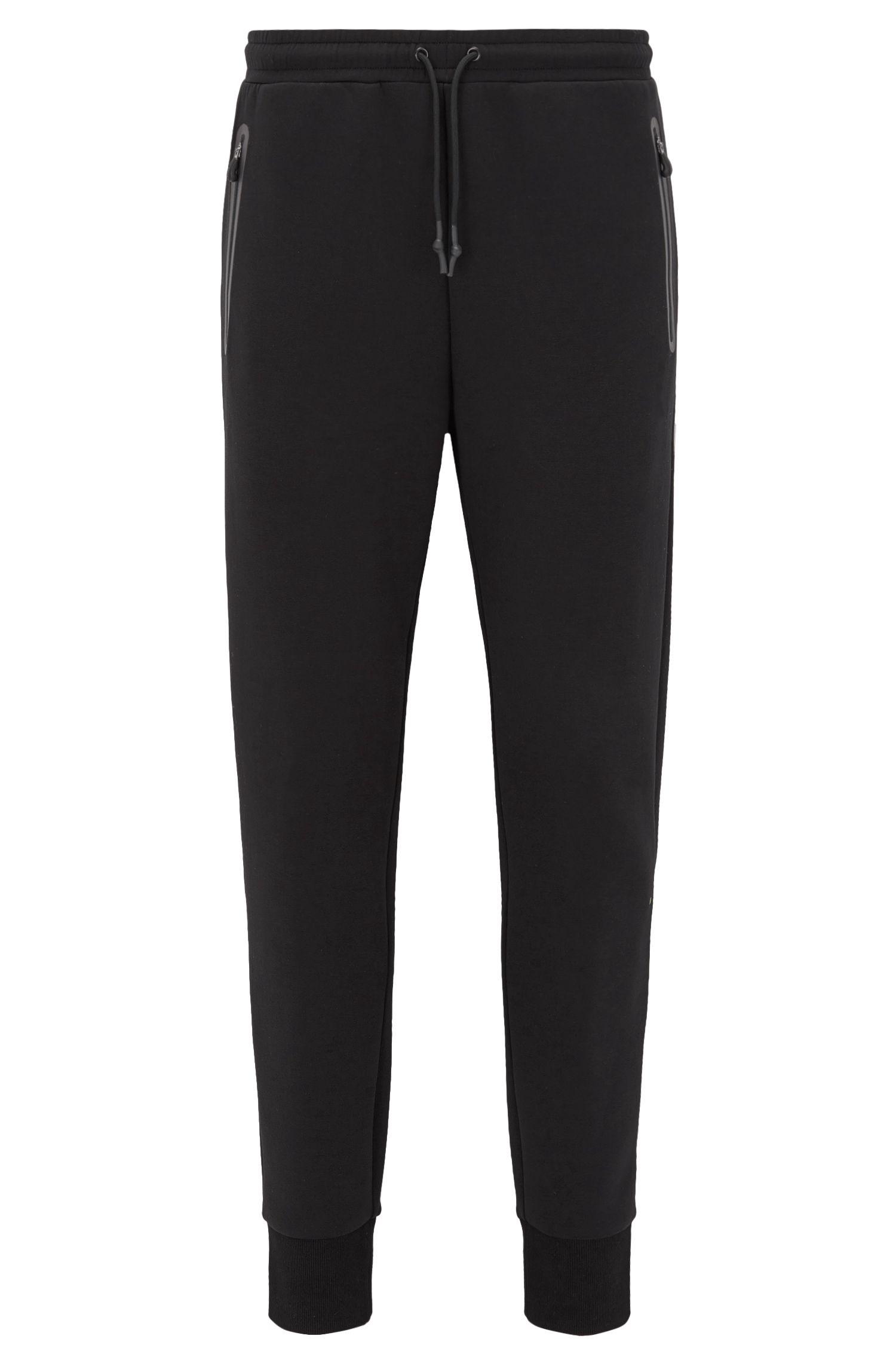 Pantalones de chándal slim fit con puños en mezcla de algodón