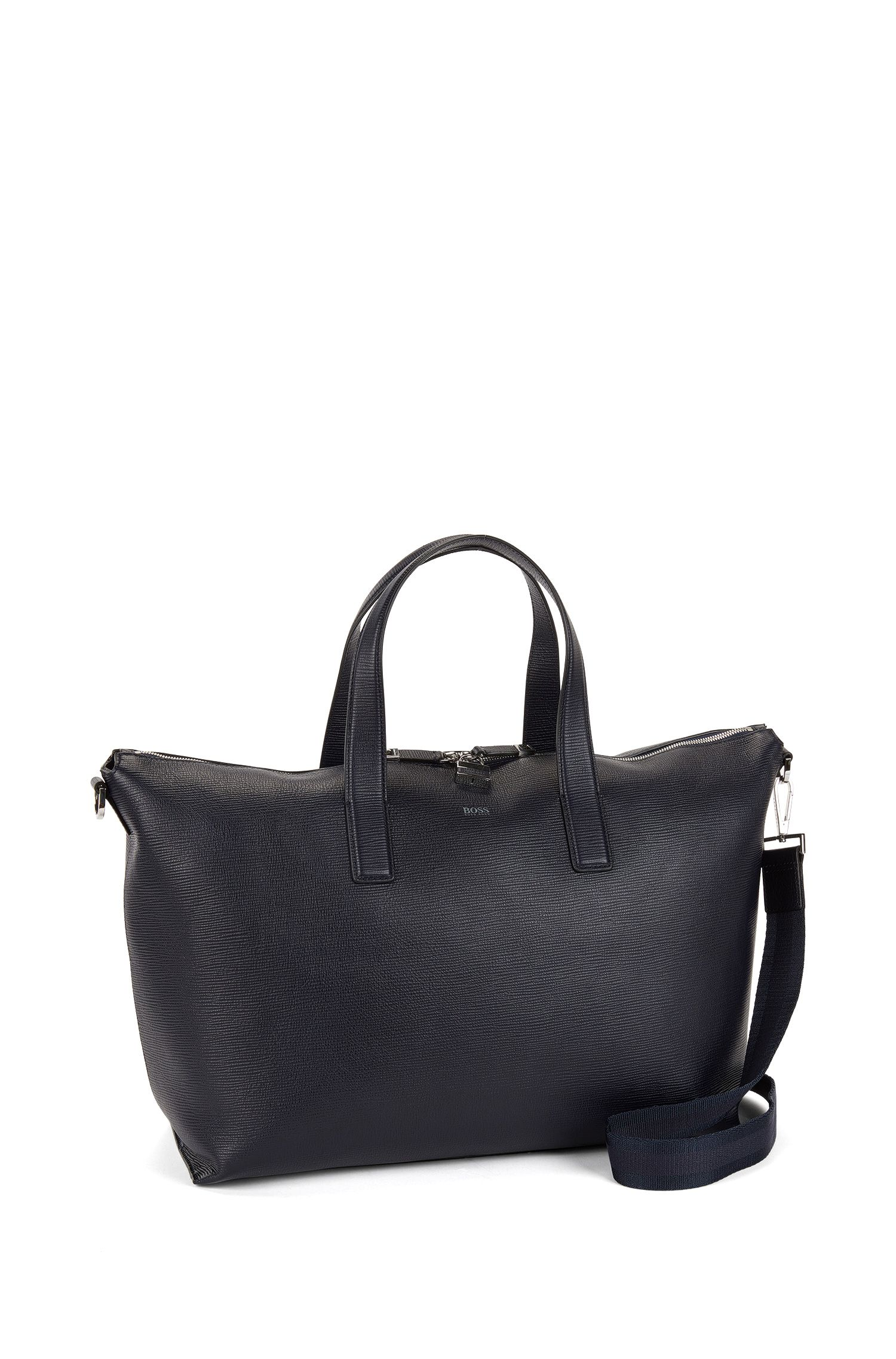 Holdall in printed leather with two-way zip