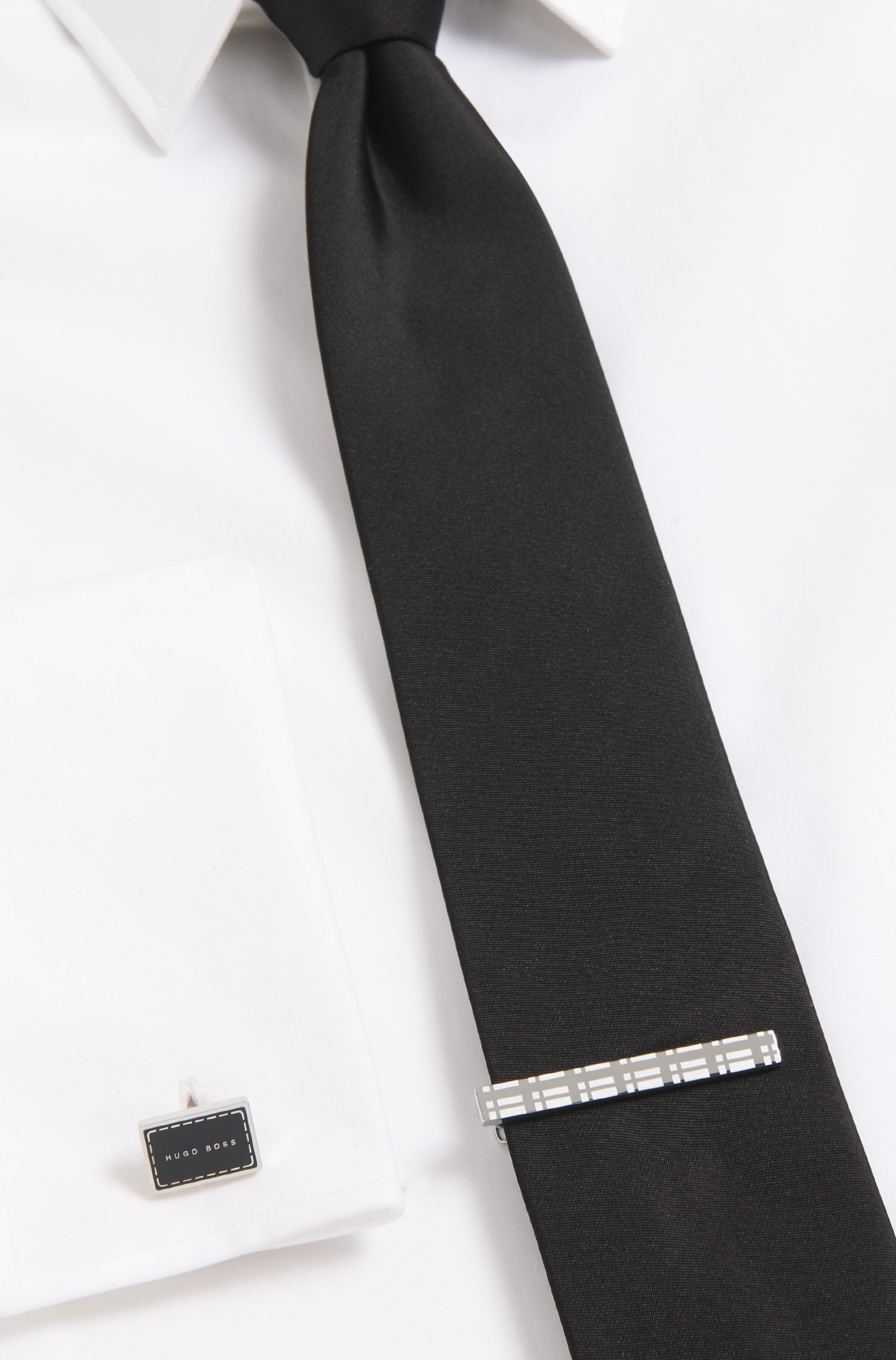 Tie clip with hand-polished check pattern