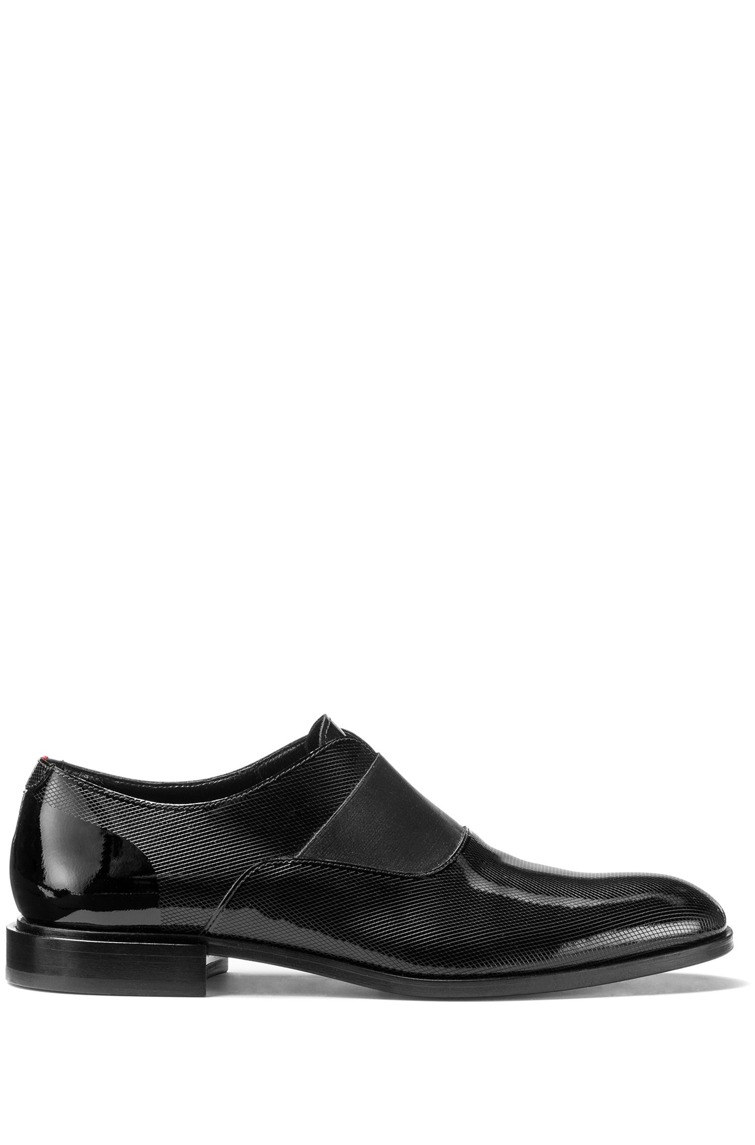 Slip-on shoes in patent leather with laser detail