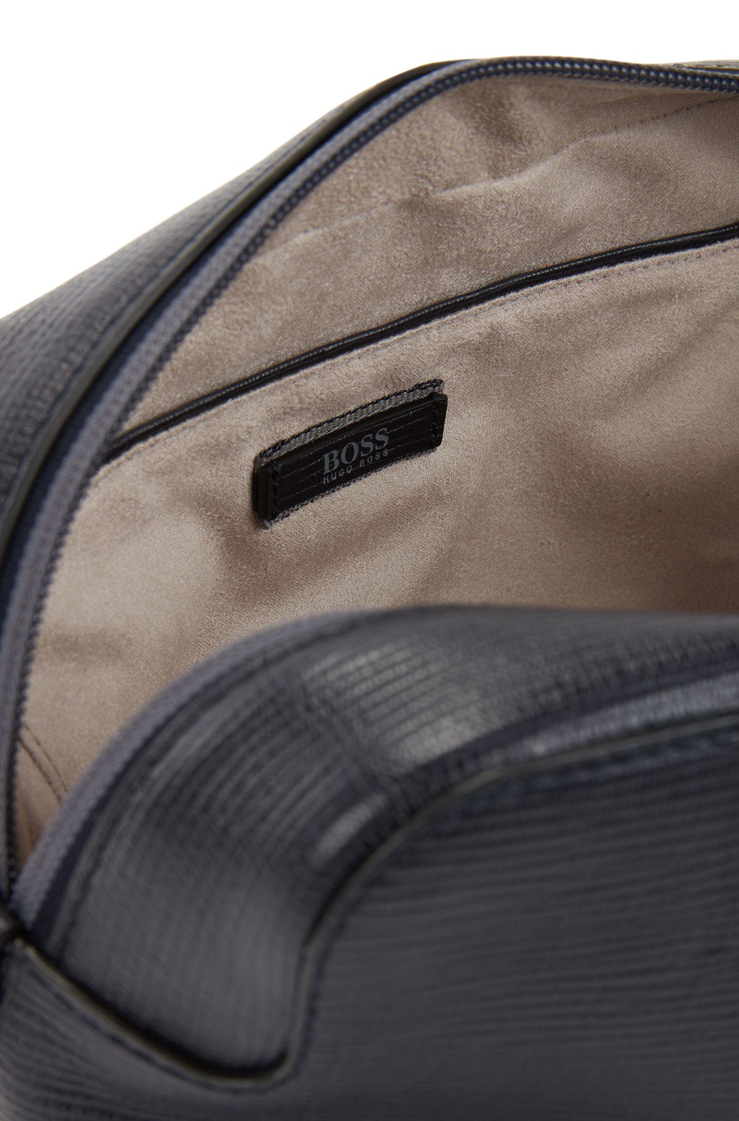 Wash bag in printed Italian leather