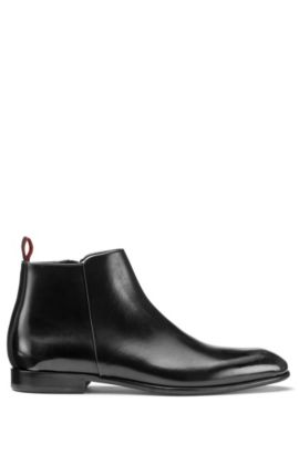Brush-off leather boots with side zip, Black