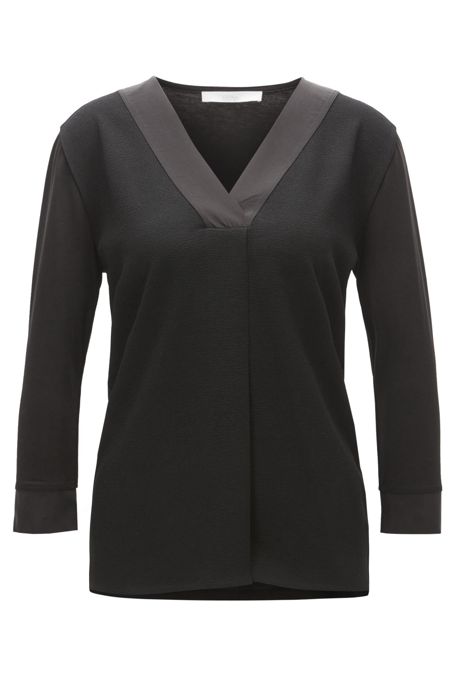 Tunic-style top with structured front panel and silk trims
