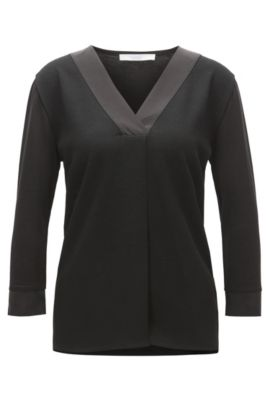 Tunic-style top with structured front panel and silk trims, Black