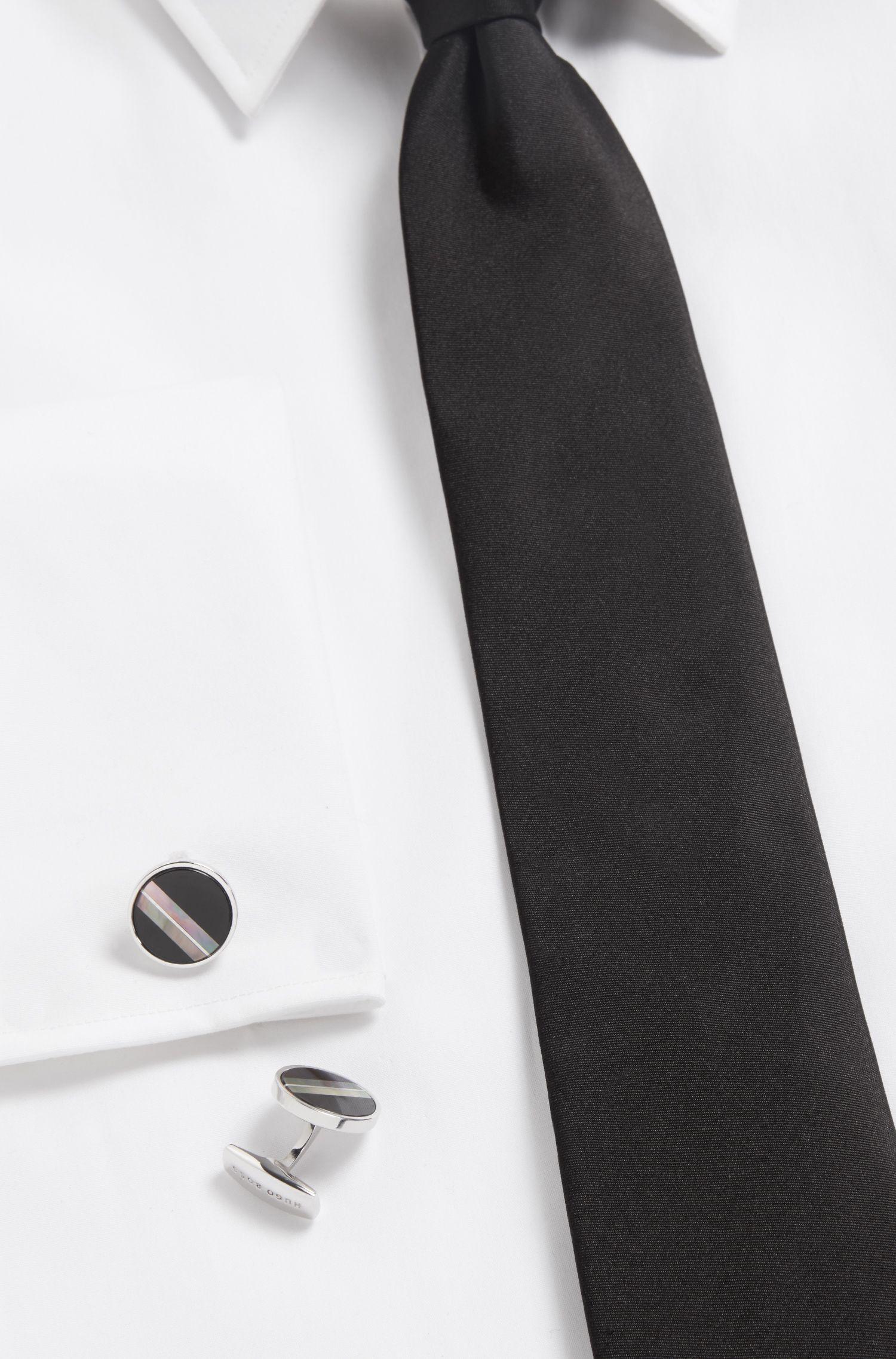 Boutons de manchette ronds incrustés de nacre et d'onyx noir