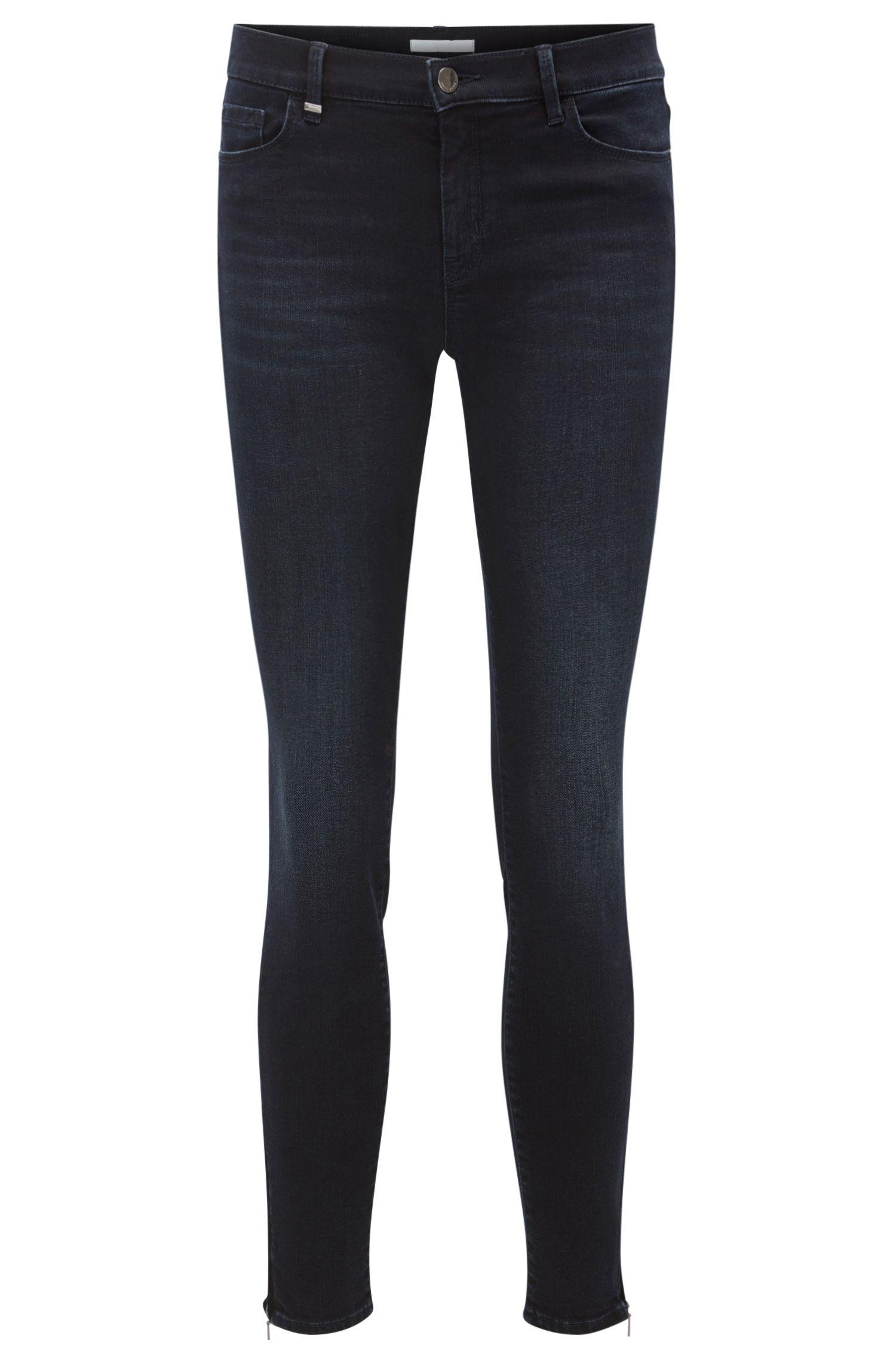 Super-stretch zip-hem jeans in a slim fit