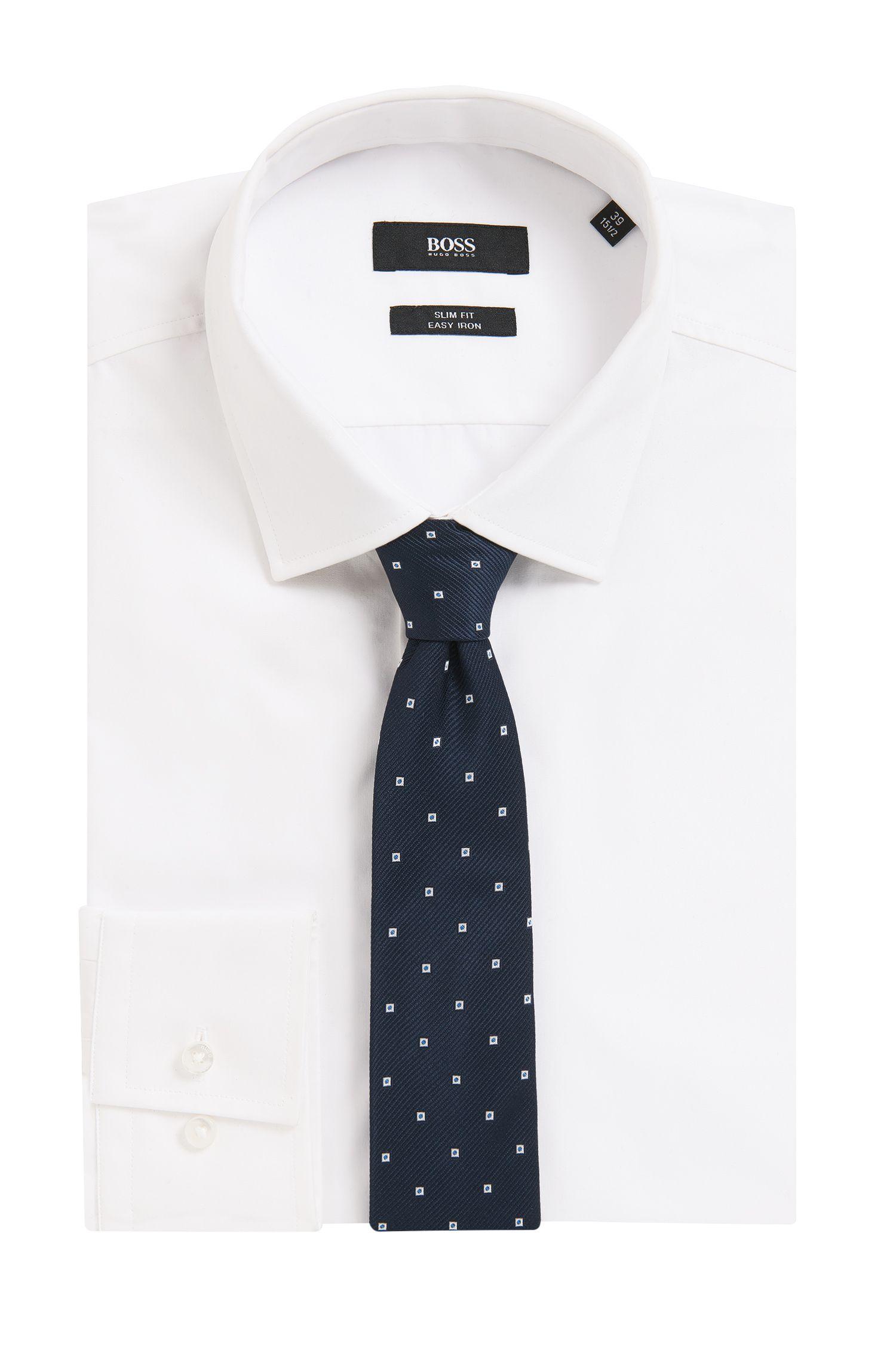 Cravate à motif tissée teinte, en jacquard de soie