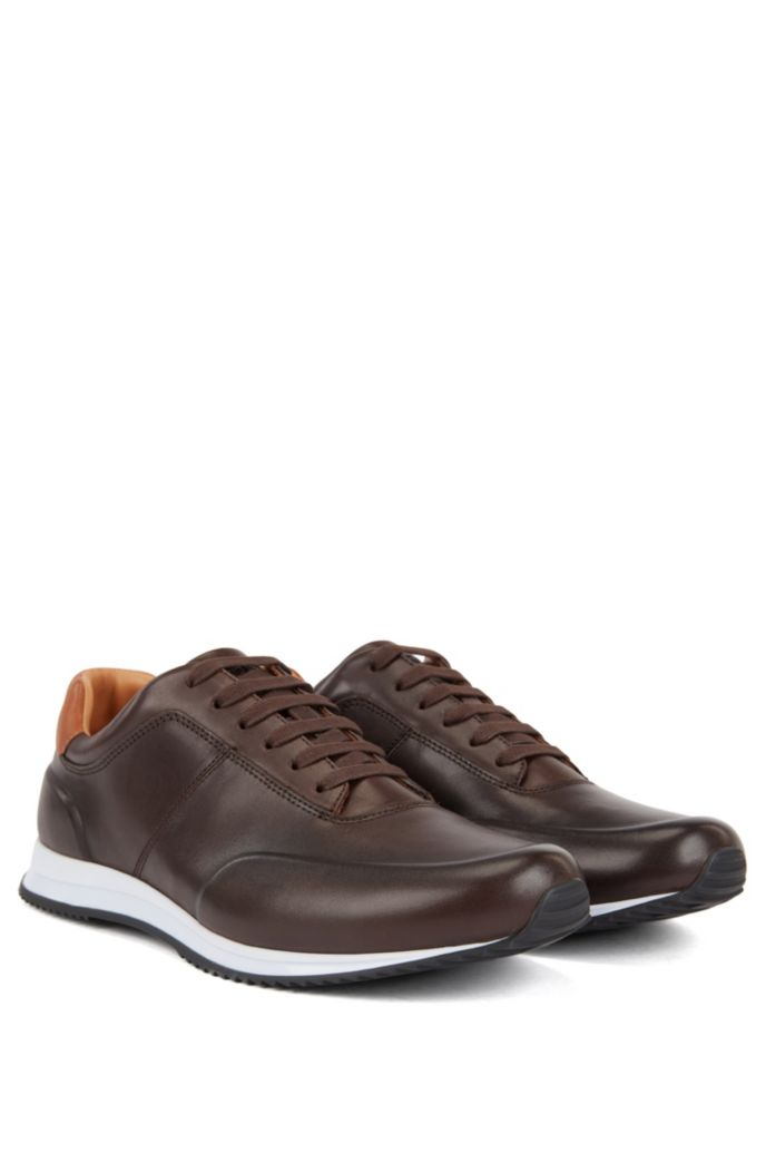 Lace-up trainers in polished leather