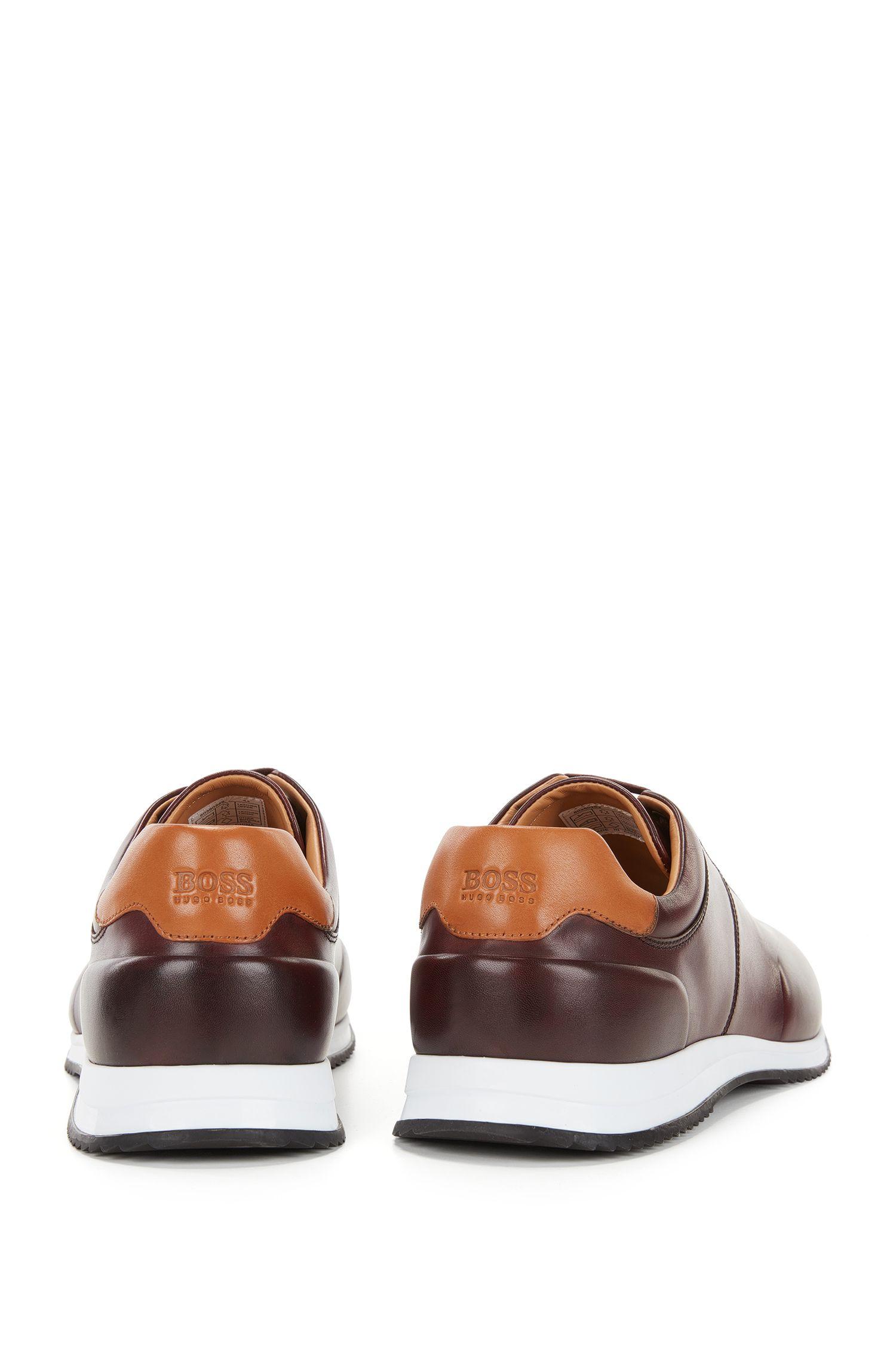 Sneakers stringate in pelle lucida