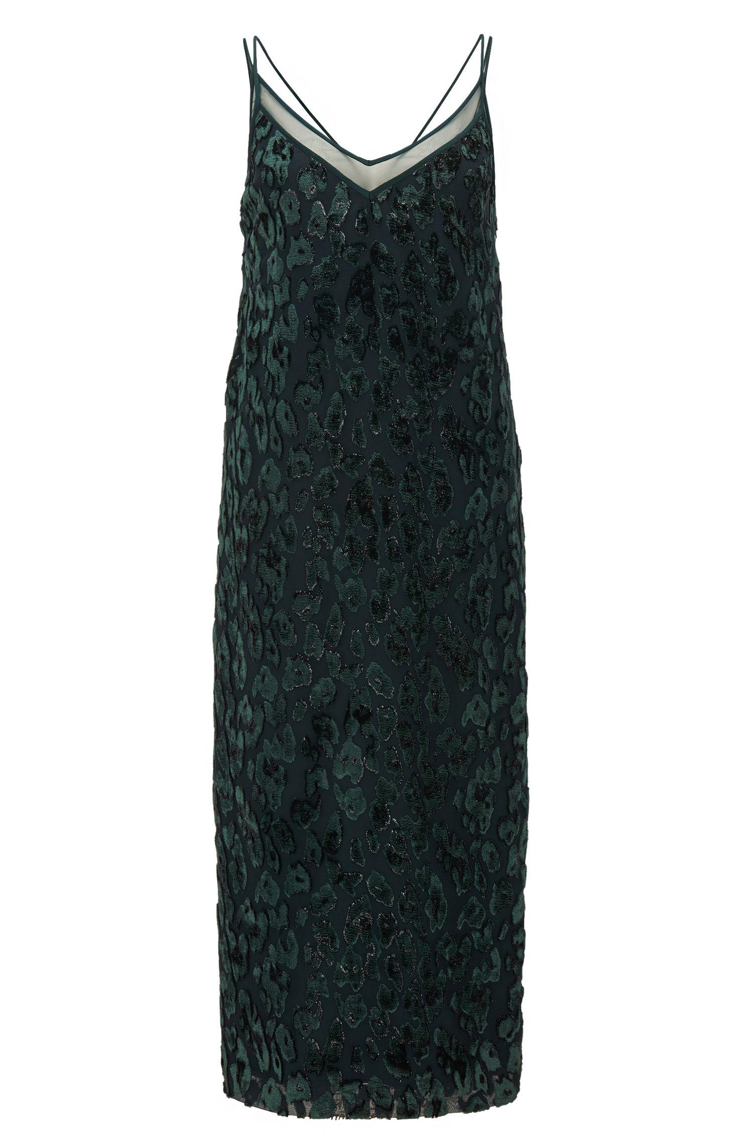 Gemustertes Cocktailkleid aus Material-Mix mit transparentem V-Ausschnitt