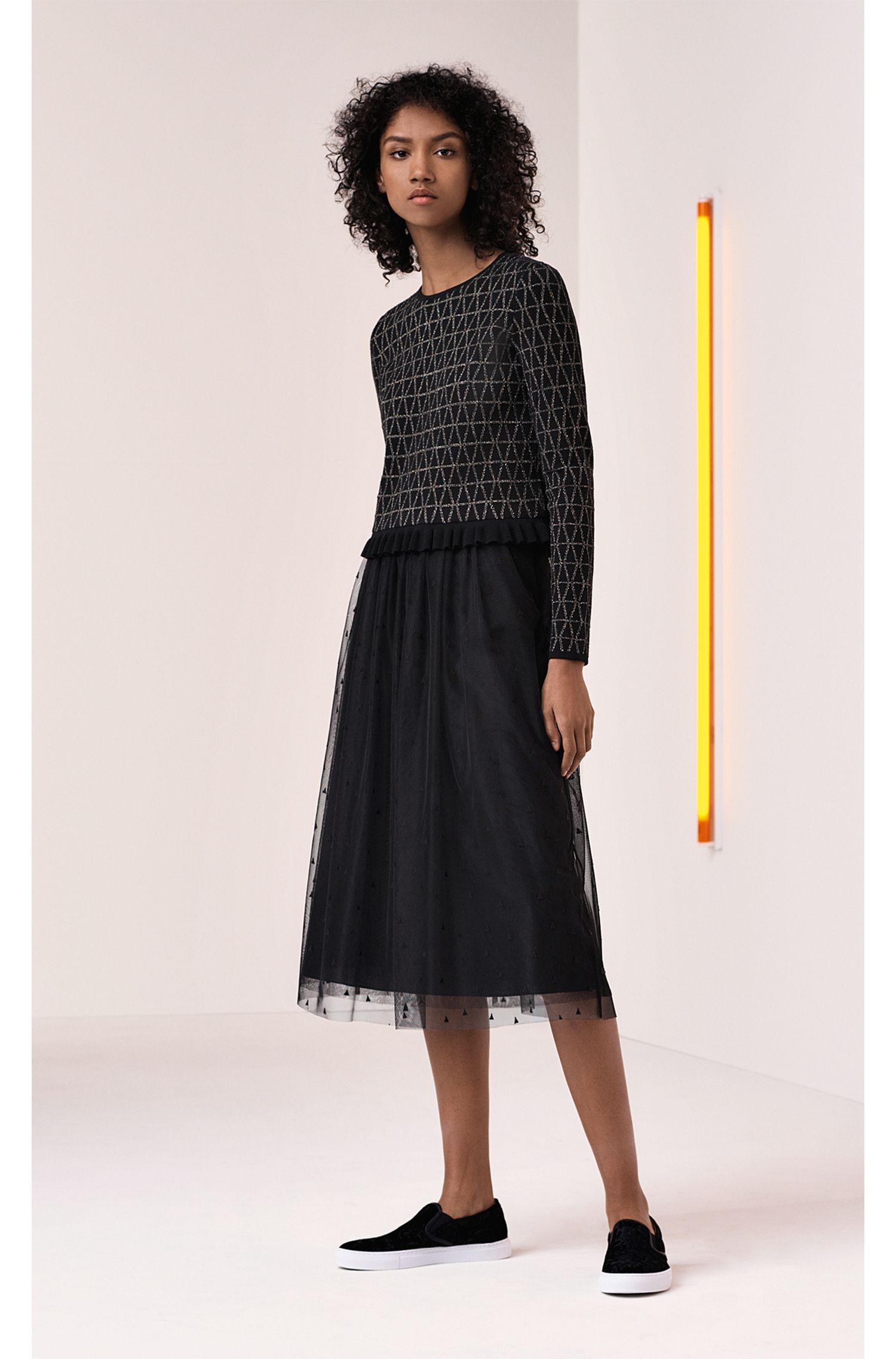 Jersey de jacquard con escote redondo y dobladillo con volante