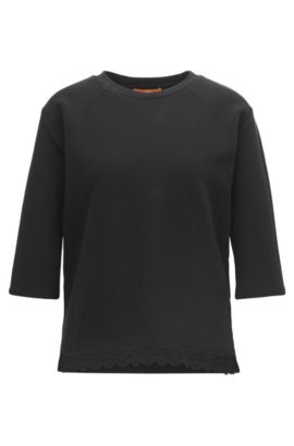 Ottoman jersey top with raglan sleeves and lace hem, Zwart