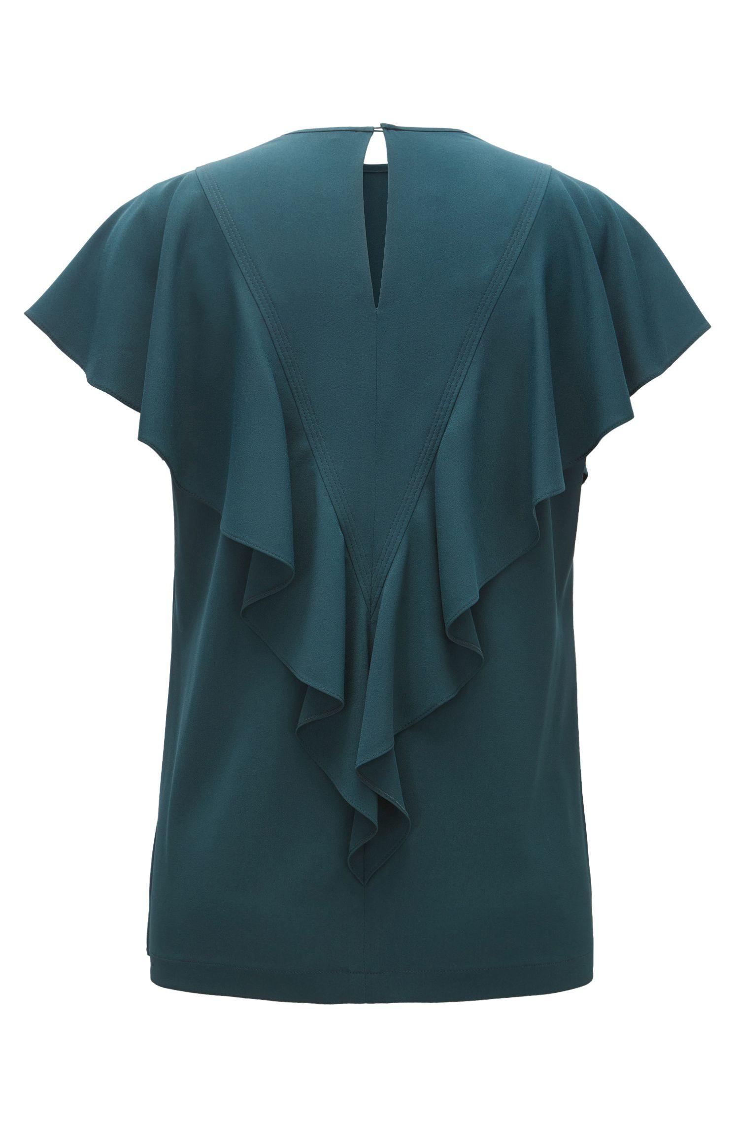 Blusa in crêpe stropicciato con volant in sbieco