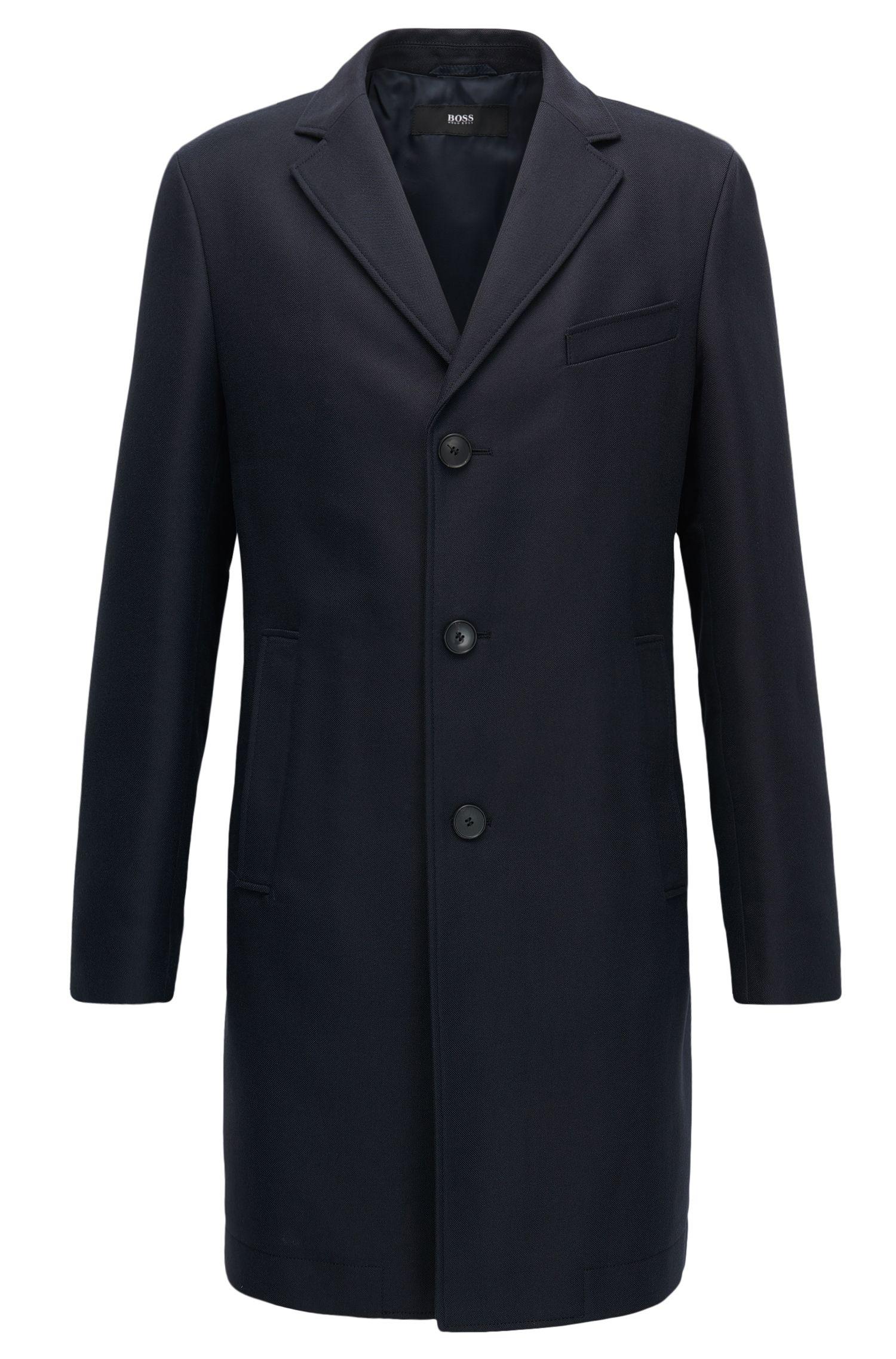 Slim-fit coat in water-repellent fabric