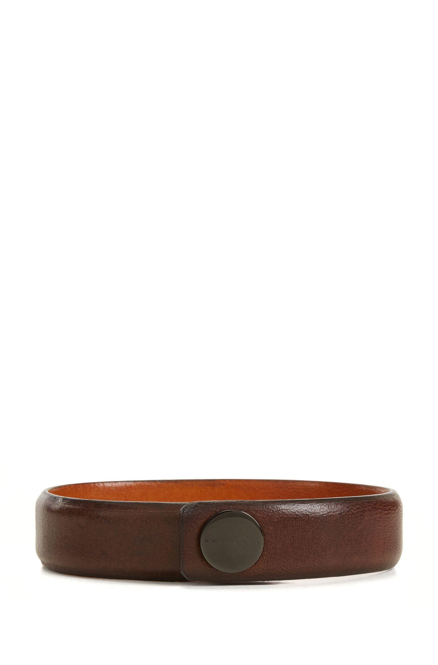 Armband van generfd rundleer met drukknoopsluiting