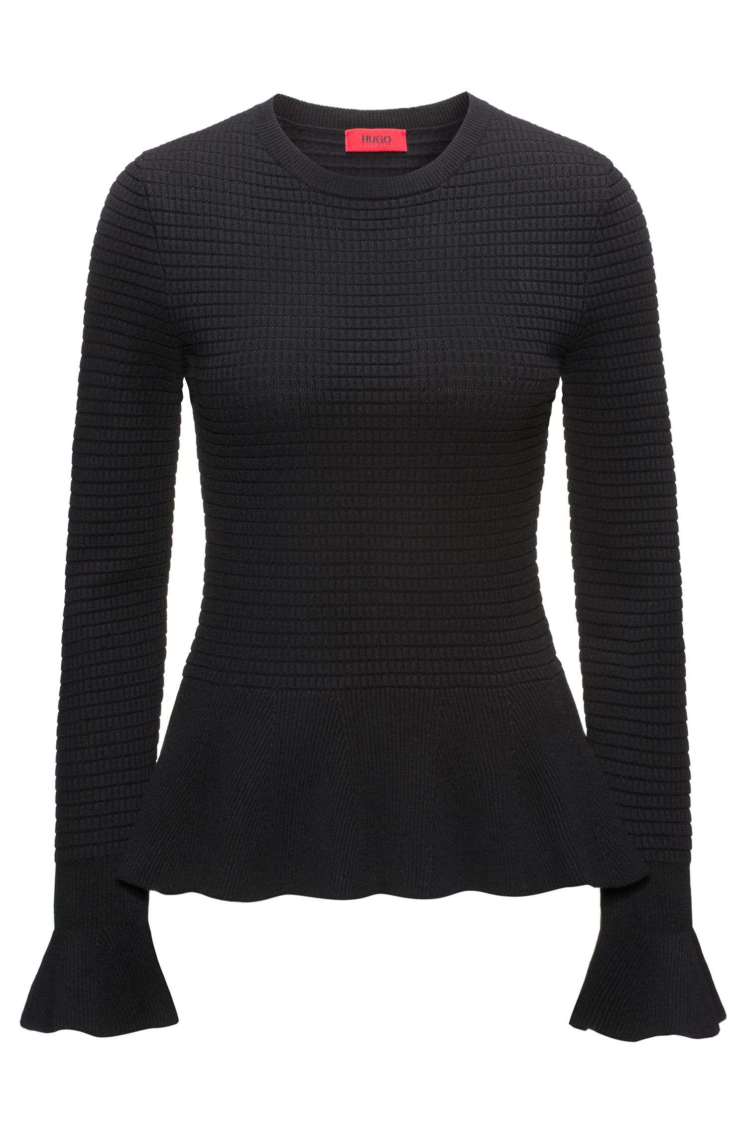 Peplum-hem knitted sweater in mixed knits