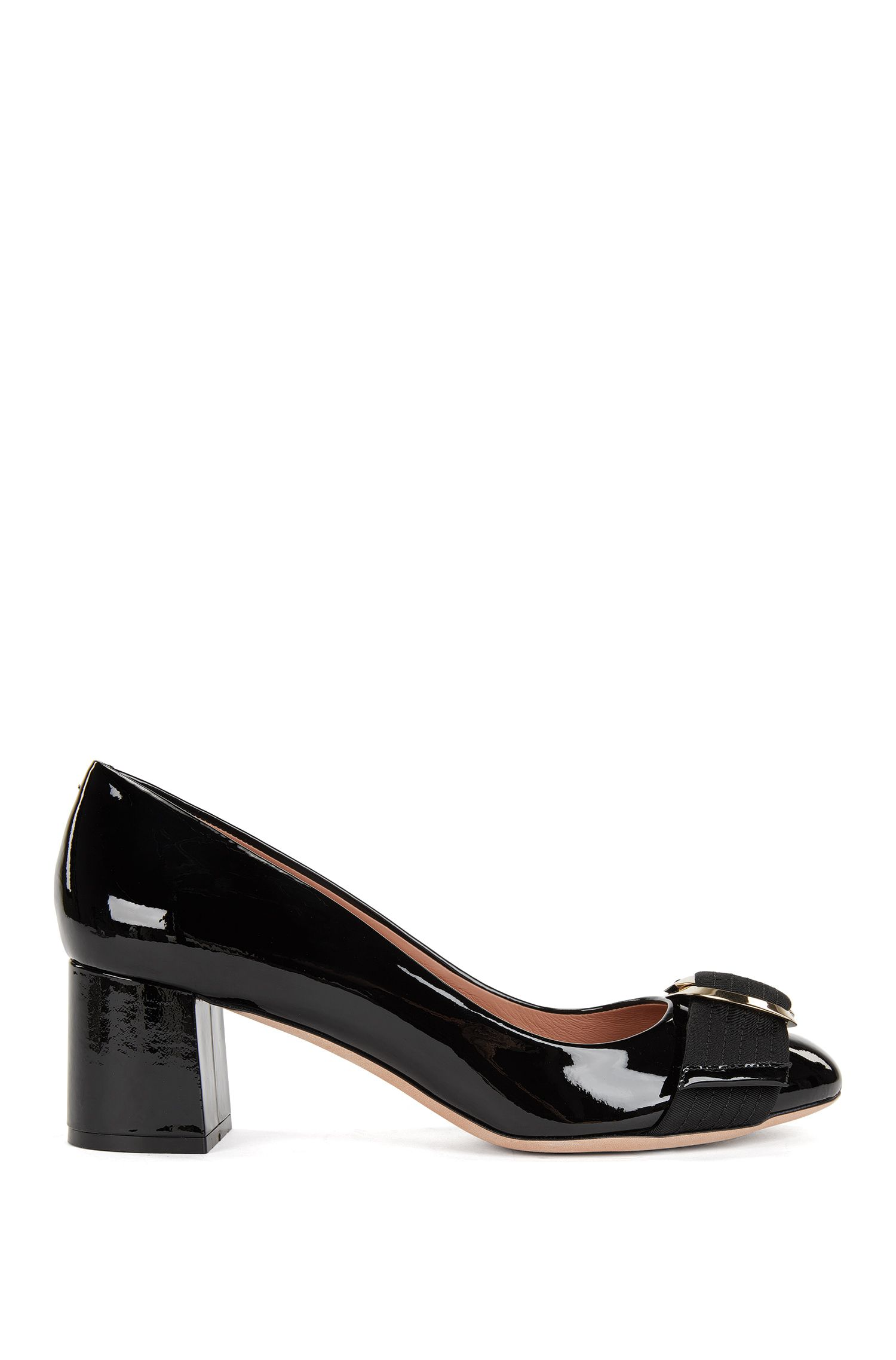 Patent leather pumps with double-ring buckle