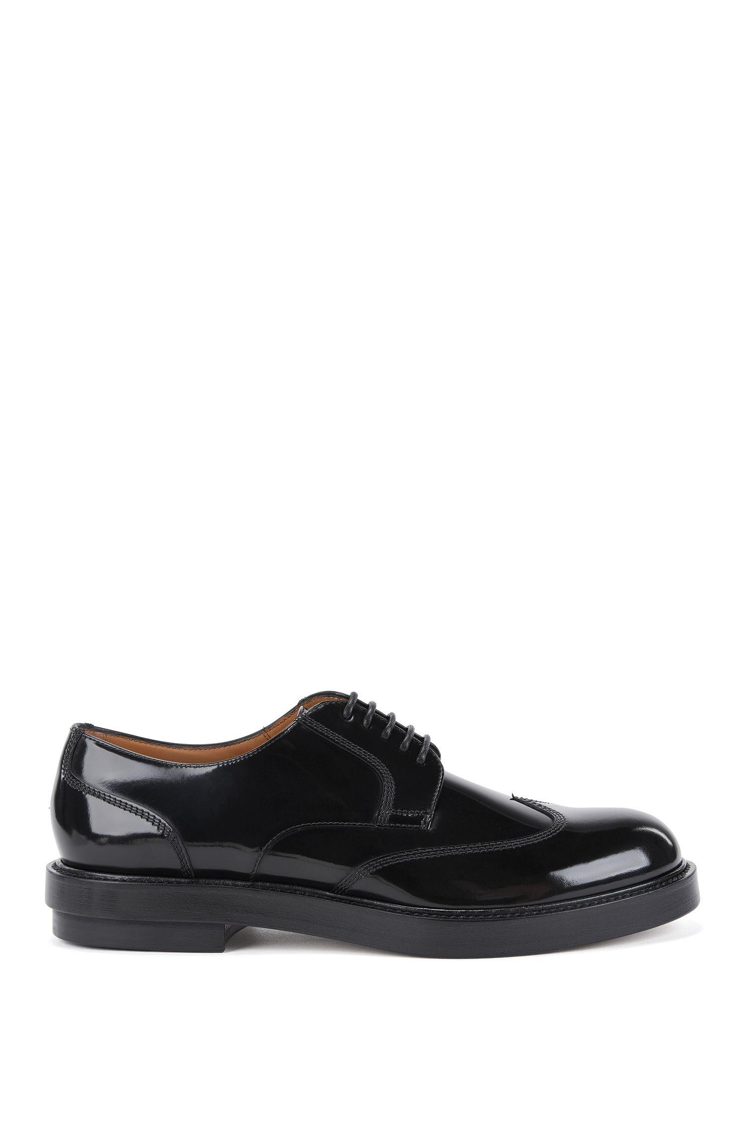 Zapatos Derby con calado wingtip en piel cepillada