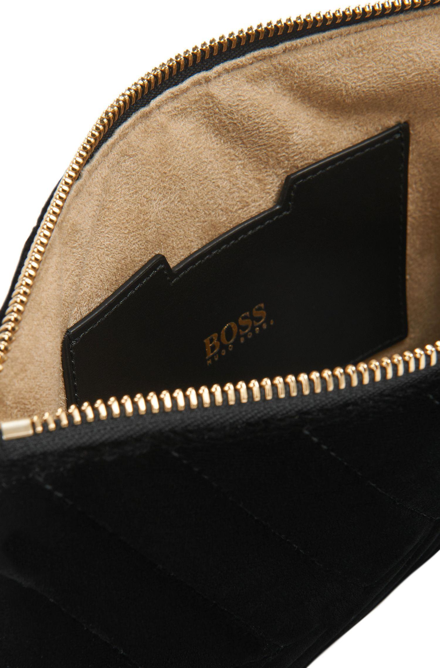 Pochette en velours italien, zippée sur le dessus