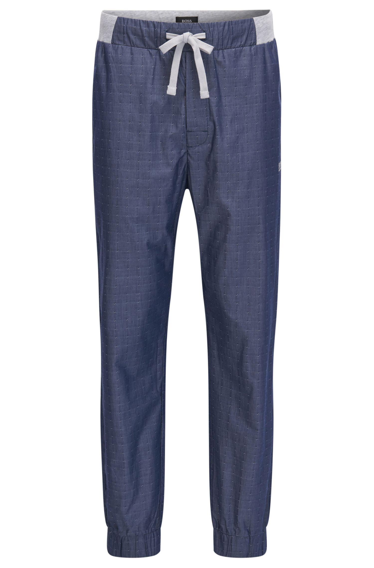 Bas de pyjama resserré au bas des jambes, en coton avec fils coupés