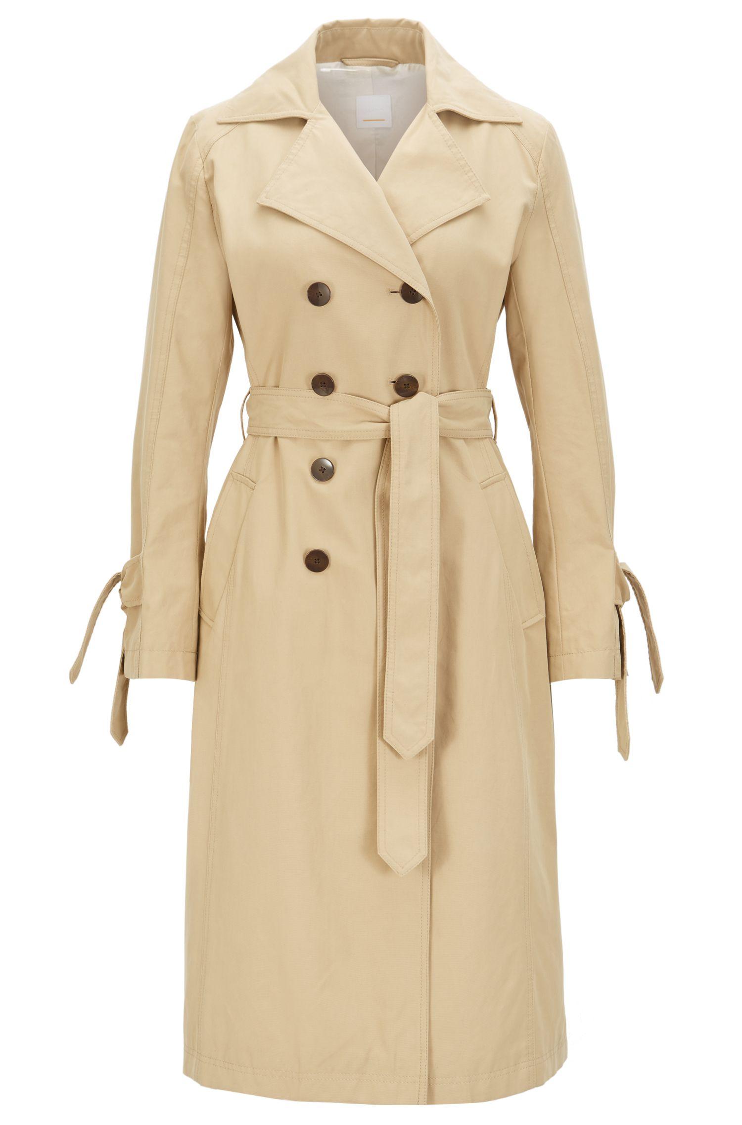 Trench-coat imperméable doté de brides aux manches