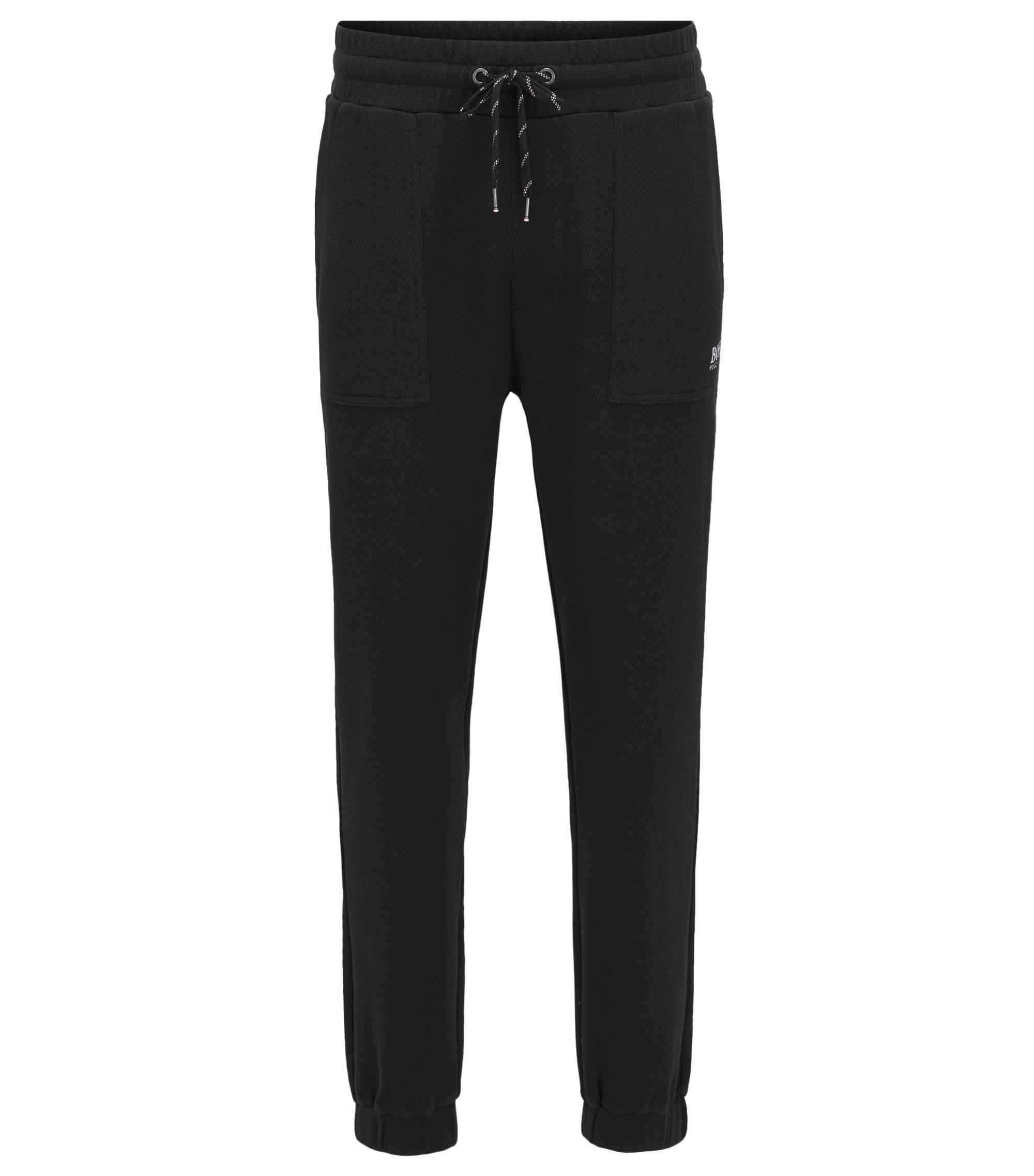 Pantaloni per il tempo libero in piqué di misto cotone con fondo gamba elastico, Nero