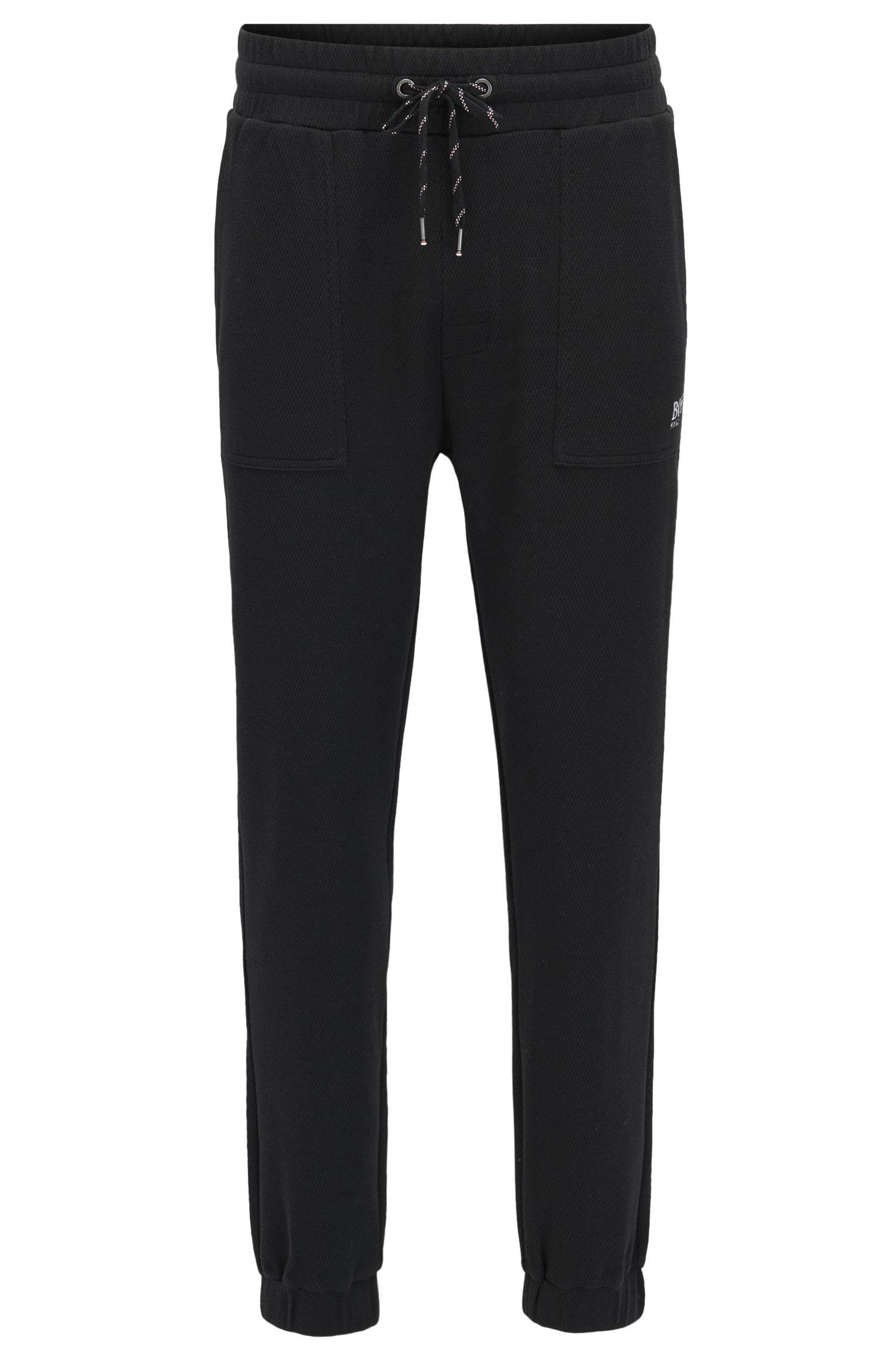 Cuffed loungewear trousers in cotton-blend piqué