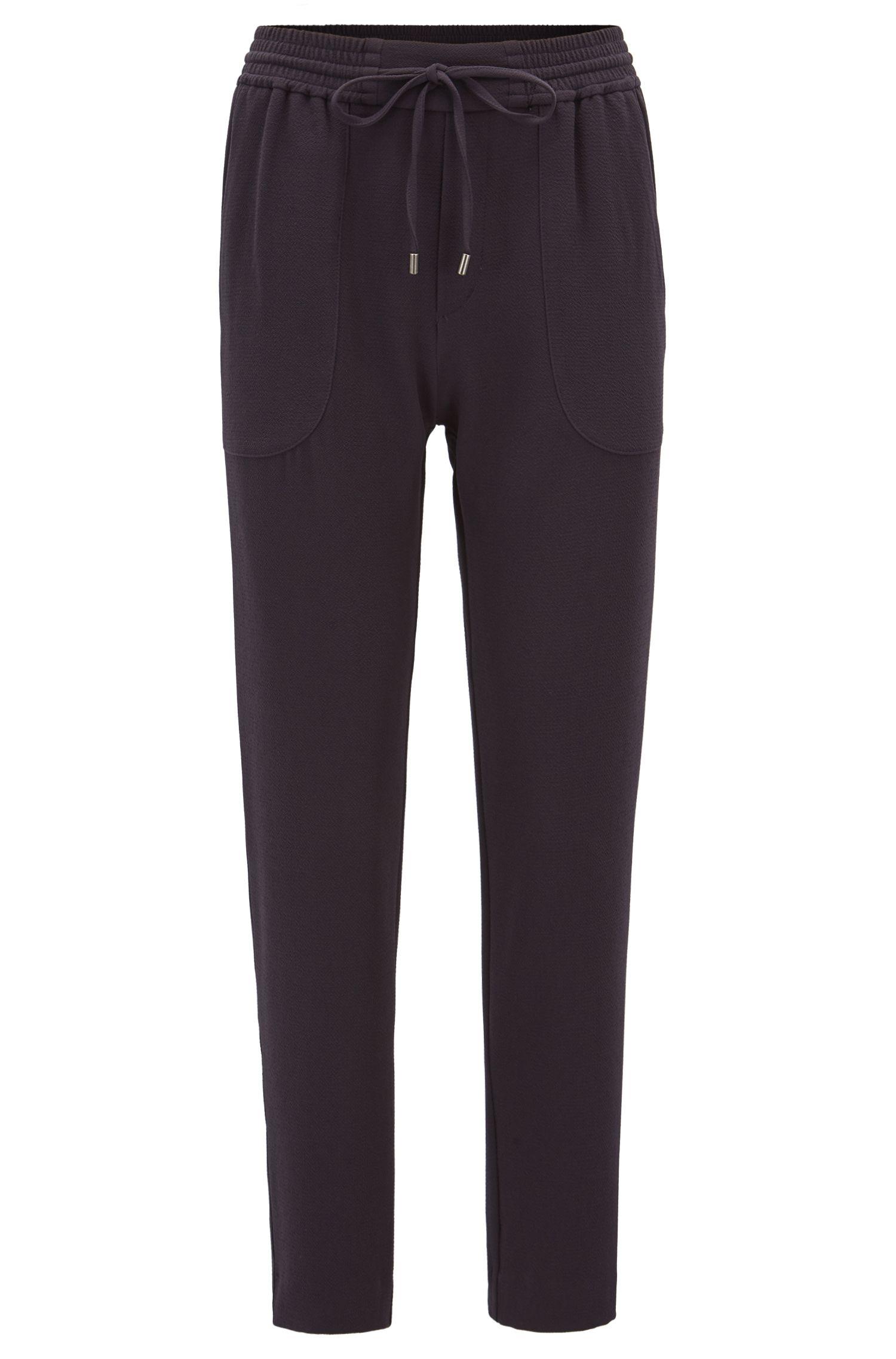 Pantaloni relaxed fit con lacci in crêpe elasticizzato effetto stropicciato