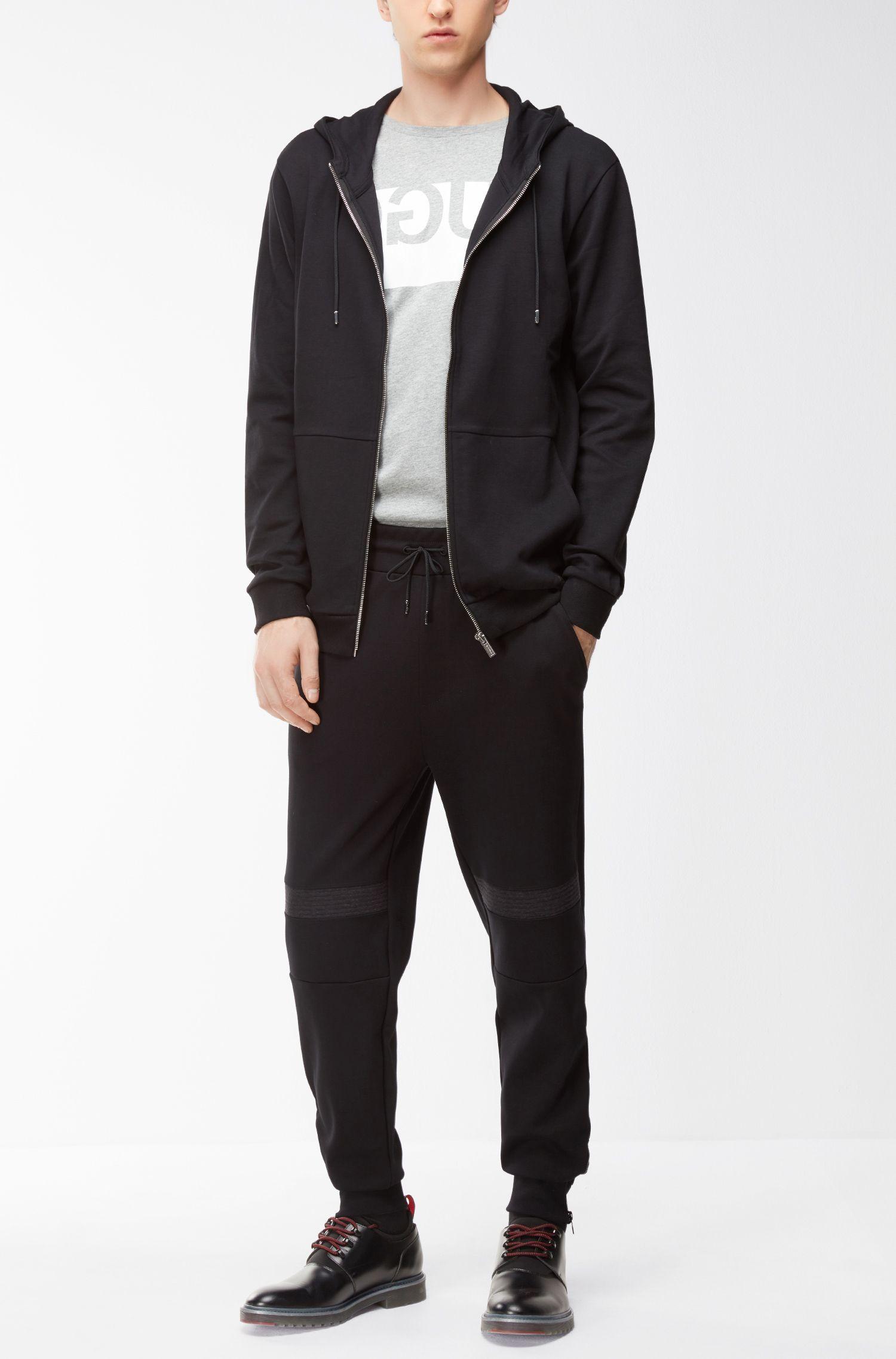 Exklusiv im Online-Shop: Regular-Fit T-Shirt aus Baumwolle mit spiegelverkehrtem Logo