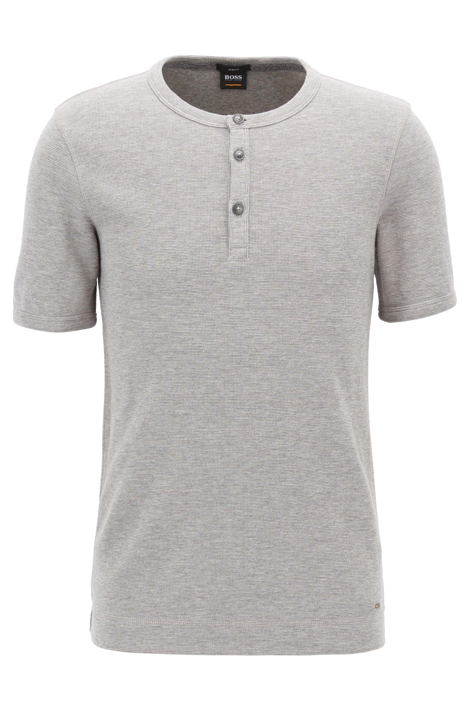Camiseta slim fit estilo Henley en algodón jaspeado