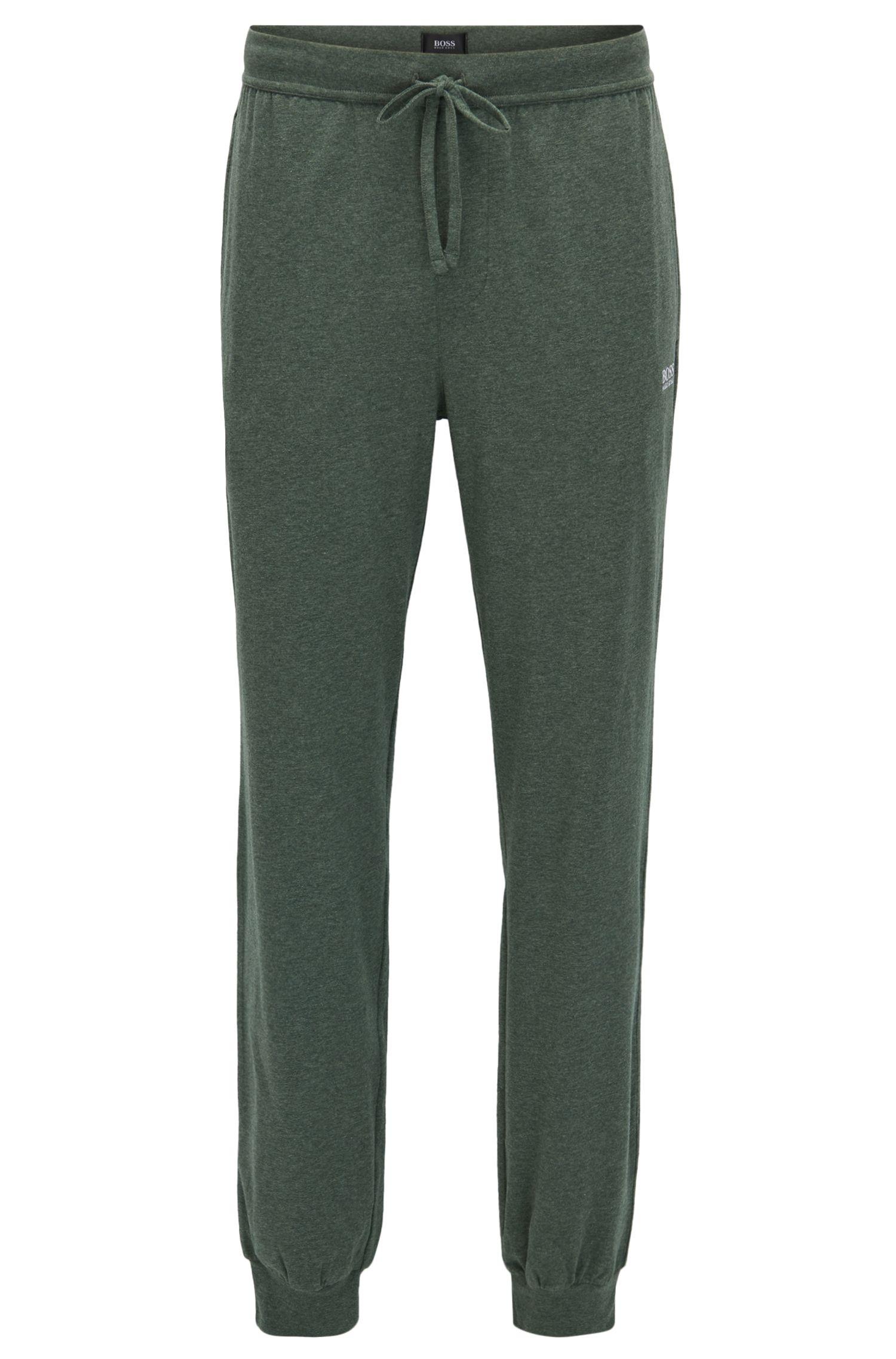 Pantalones loungewear con puños en algodón elástico