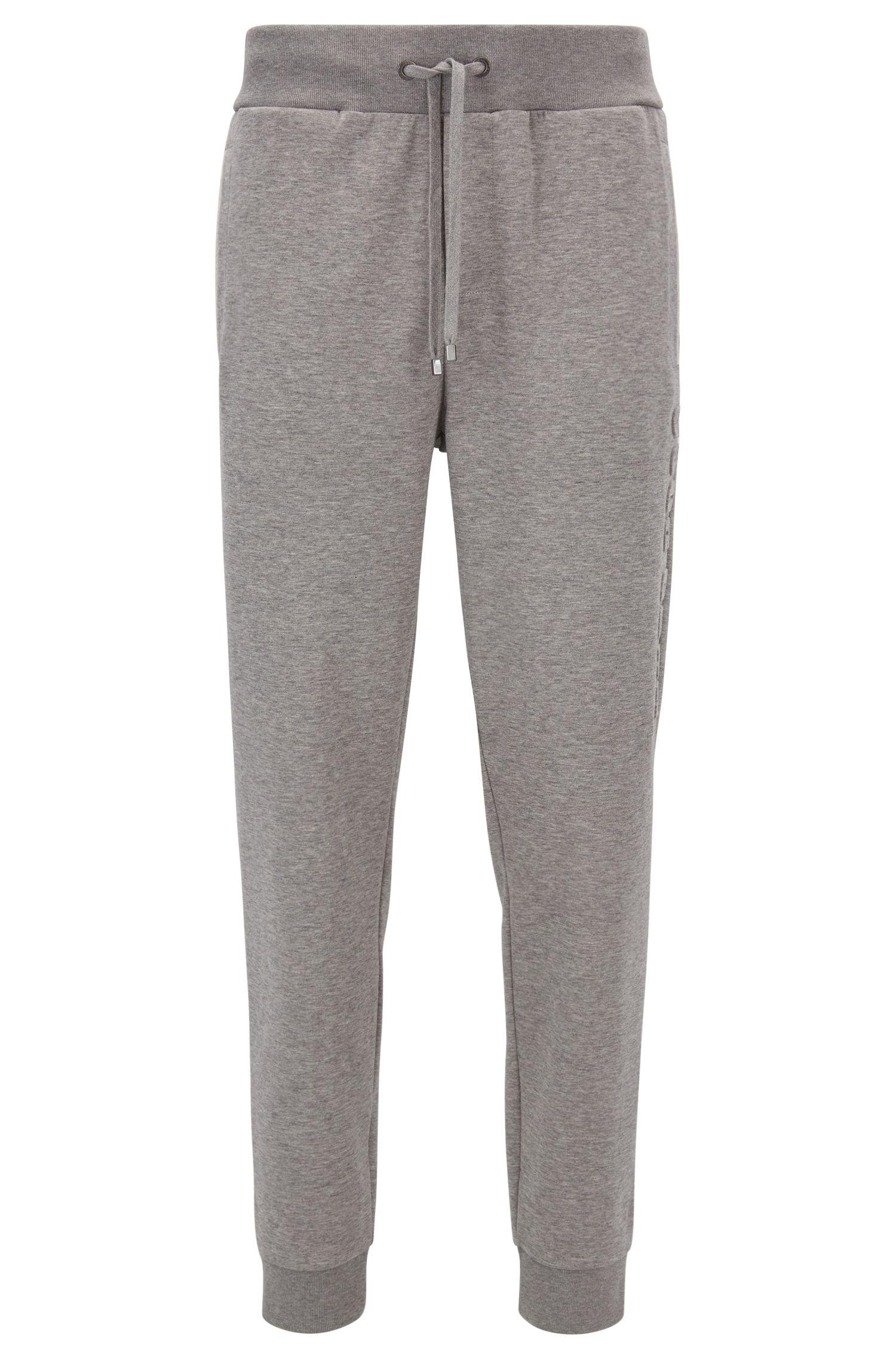 Cotton-blend loungewear bottoms with vertical logo